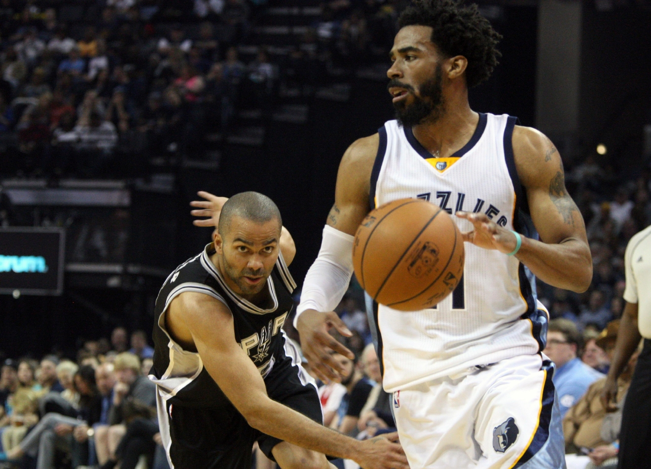 San Antonio Spurs' Tony Parker watches the ball as Memphis Grizzlies' Mike Conley looks for an open shot in the first half of an NBA basketball game Saturday, March 18, 2017, in Memphis, Tenn. (AP Photo/Karen Pulfer Focht)