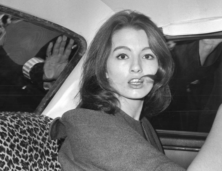FILE - in this file photo dated  July 22, 1963 Christine Keeler, a principal witnesses in the vice charges case against osteopath Dr. Stephen Ward.  The model at centre of Profumo Affair, a scandal that rocked the political establishment and forced cabinet minister to resign, has died Tuesday Dec. 5, 2017, according to a statement issued by her family.  (AP Photo/FILE)