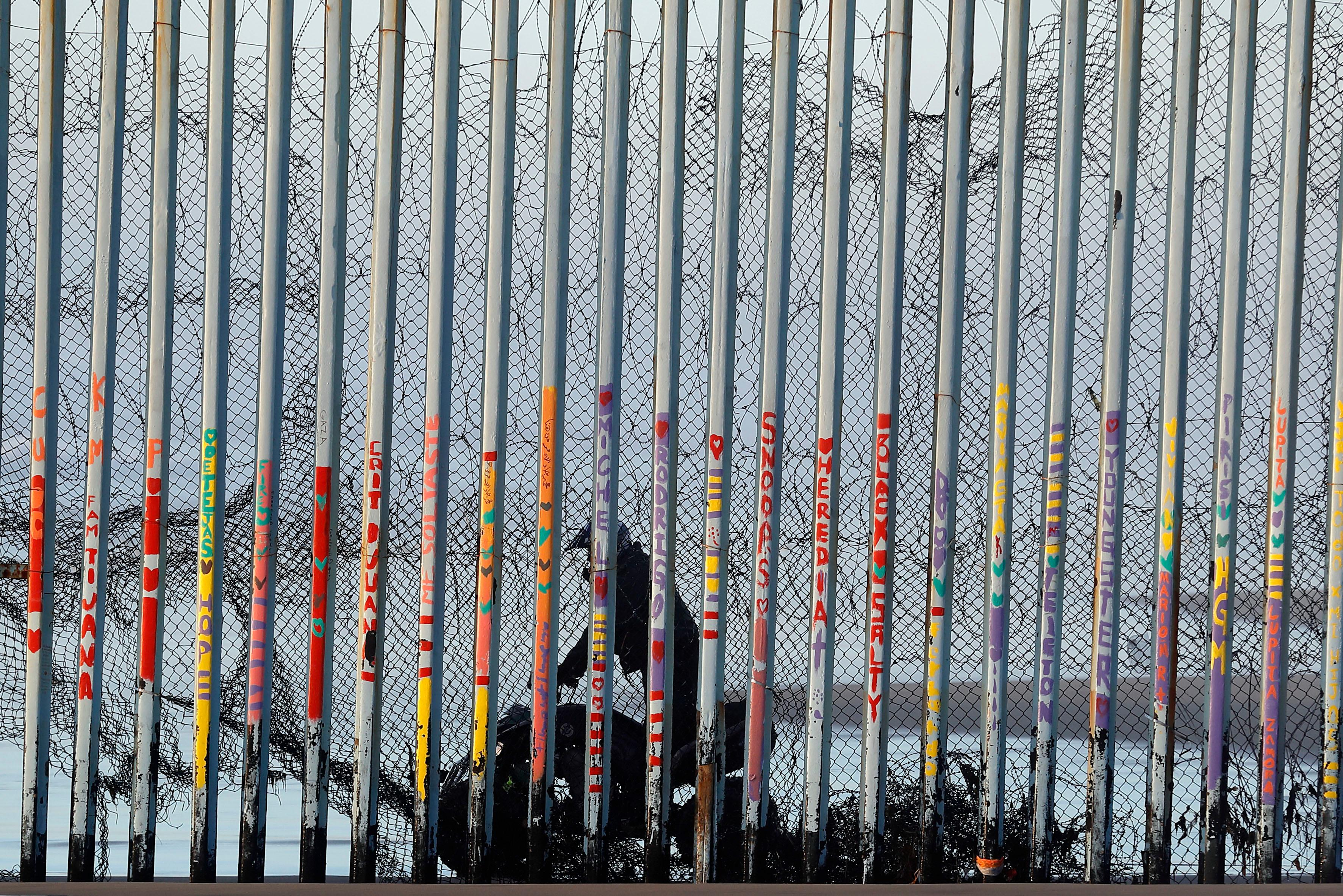 A U.S. Border Patrol agent rides a vehicle on the beach in San Diego, Wednesday, Jan. 9, 2019, seen through the border wall from Tijuana, Mexico. (AP Photo/Gregory Bull)