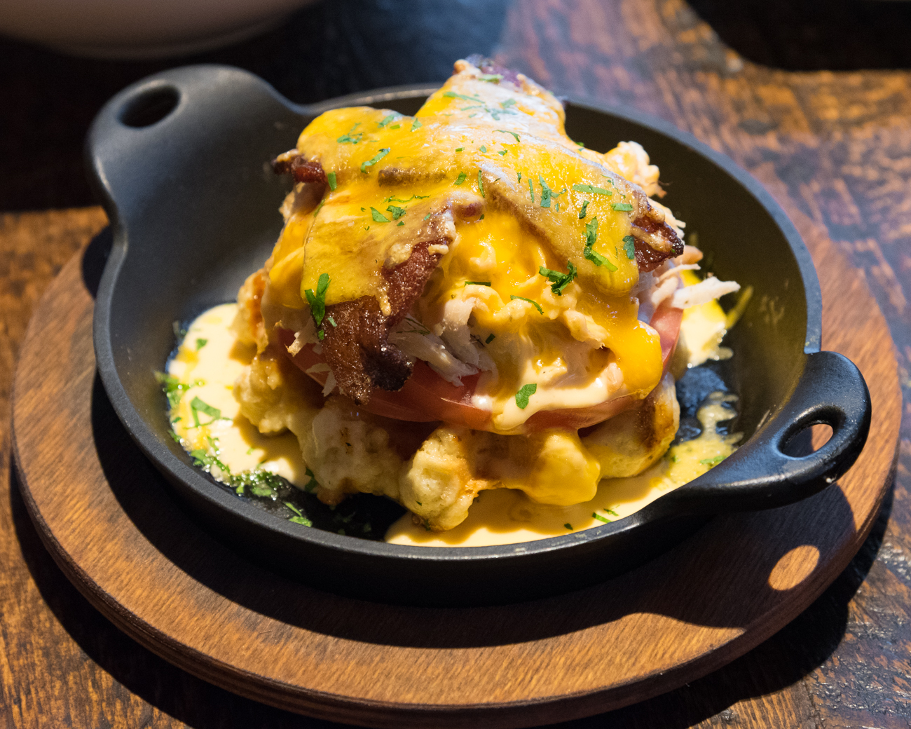 Beltucky Hot Brown: waffle, pulled turkey, sliced tomatoes, candied bacon, and cheddar Mornay / Image: Phil Armstrong, Cincinnati Refined // Published: 12.14.16