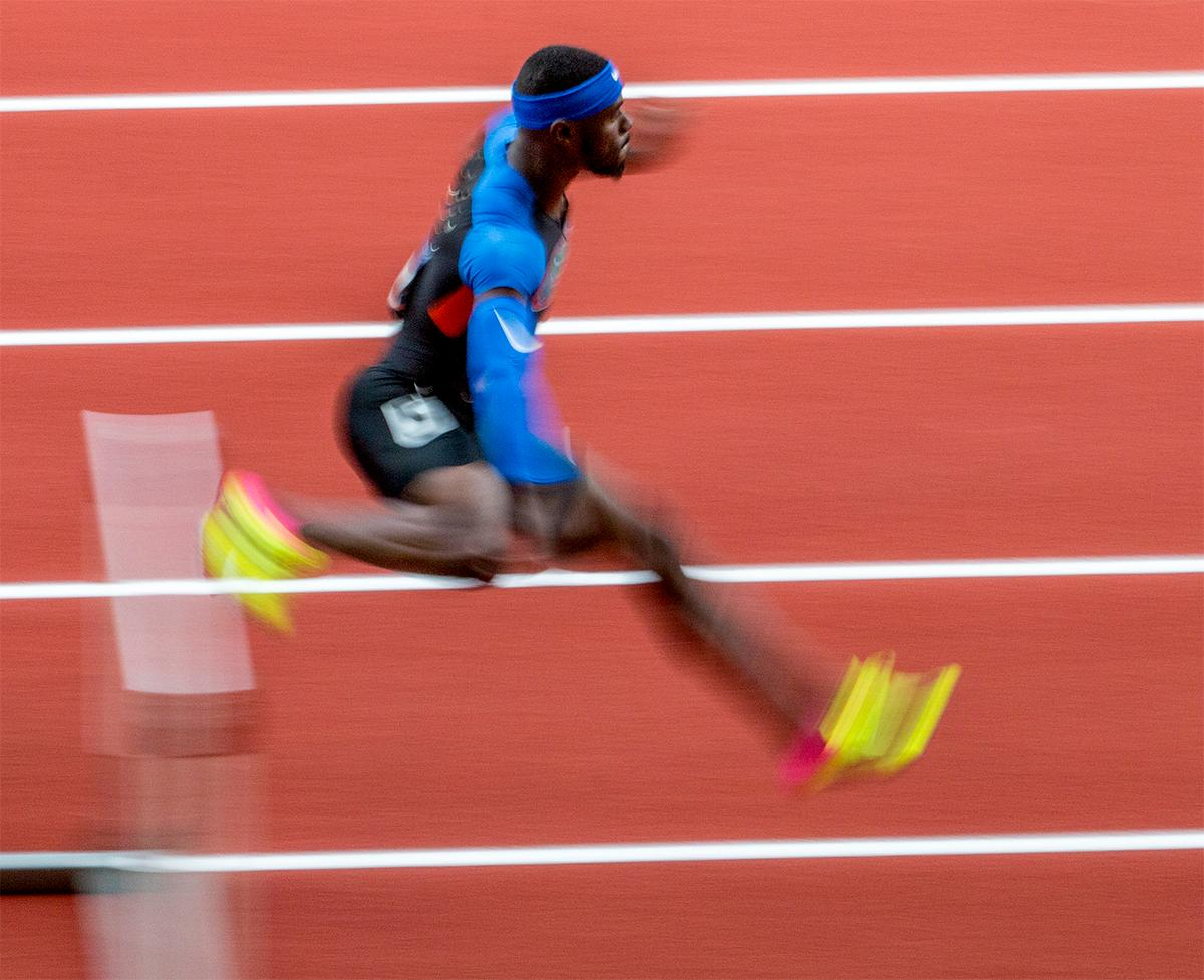 Florida's Eric Futch leaps the hurdles on the backstretch. Futch would place second overall in the semi-finals with a time of 48.66. Photo by August Frank, Oregon News Lab