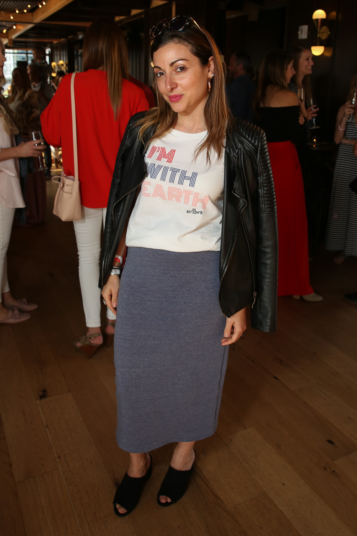 Sophie Blake's earth-supporting tee is already cool, but with a midi skirt and mules it feels pulled together.{ }(Amanda Andrade-Rhoades/DC Refined)