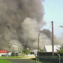 Officials: 4-alarm fire breaks out at Baltimore warehouse