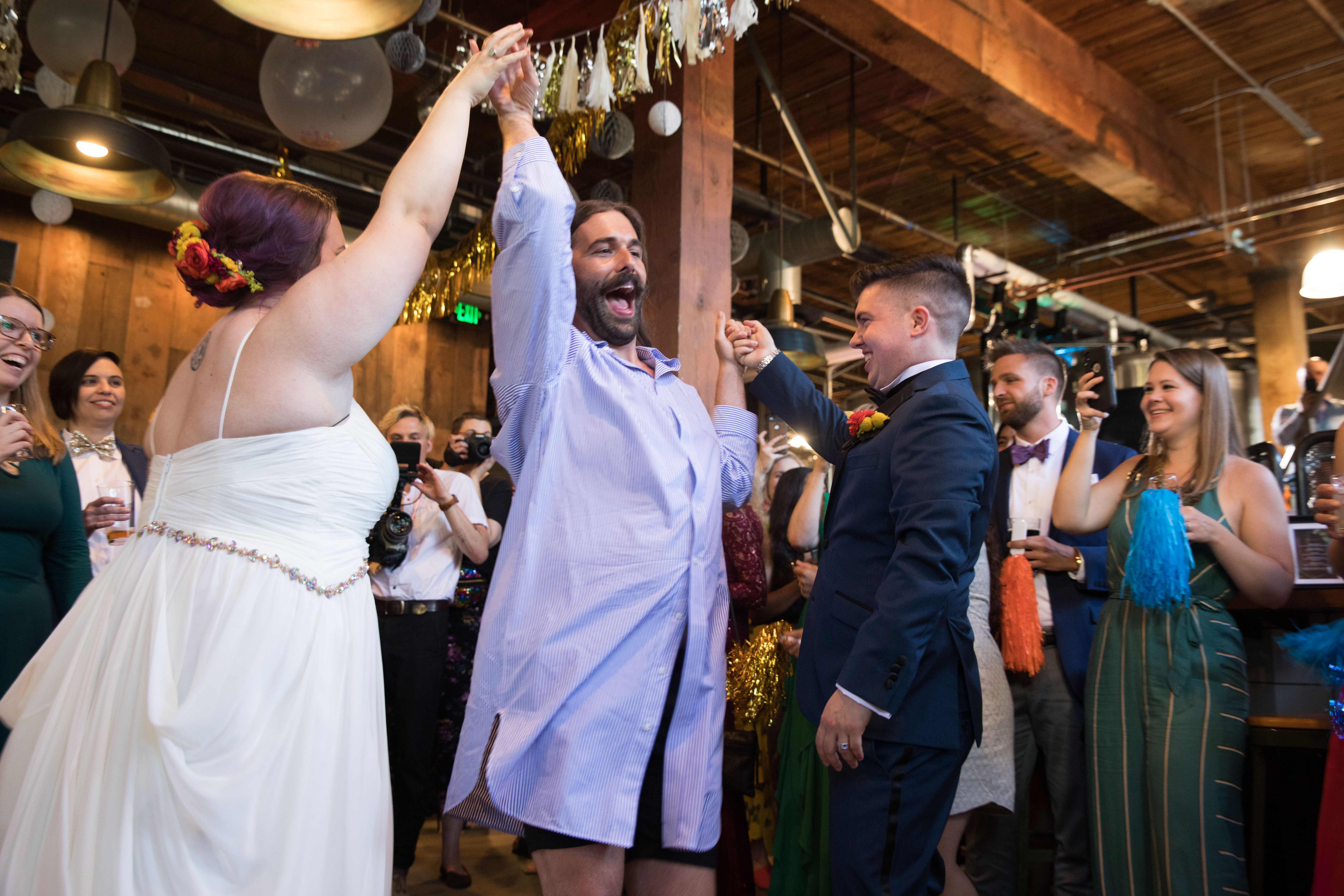 CAN YOU EVEN BELIEVE?!{ } Jonathan Van Ness celebrates with newlywed #MarryUsJVN contest winners, Megan and Haden, at Elysian Brewings Capitol Hill brewpub in Seattle on June 4, 2019. (Photo by Matt Mills McKnight/Invision for Elysian Brewing/AP Images)