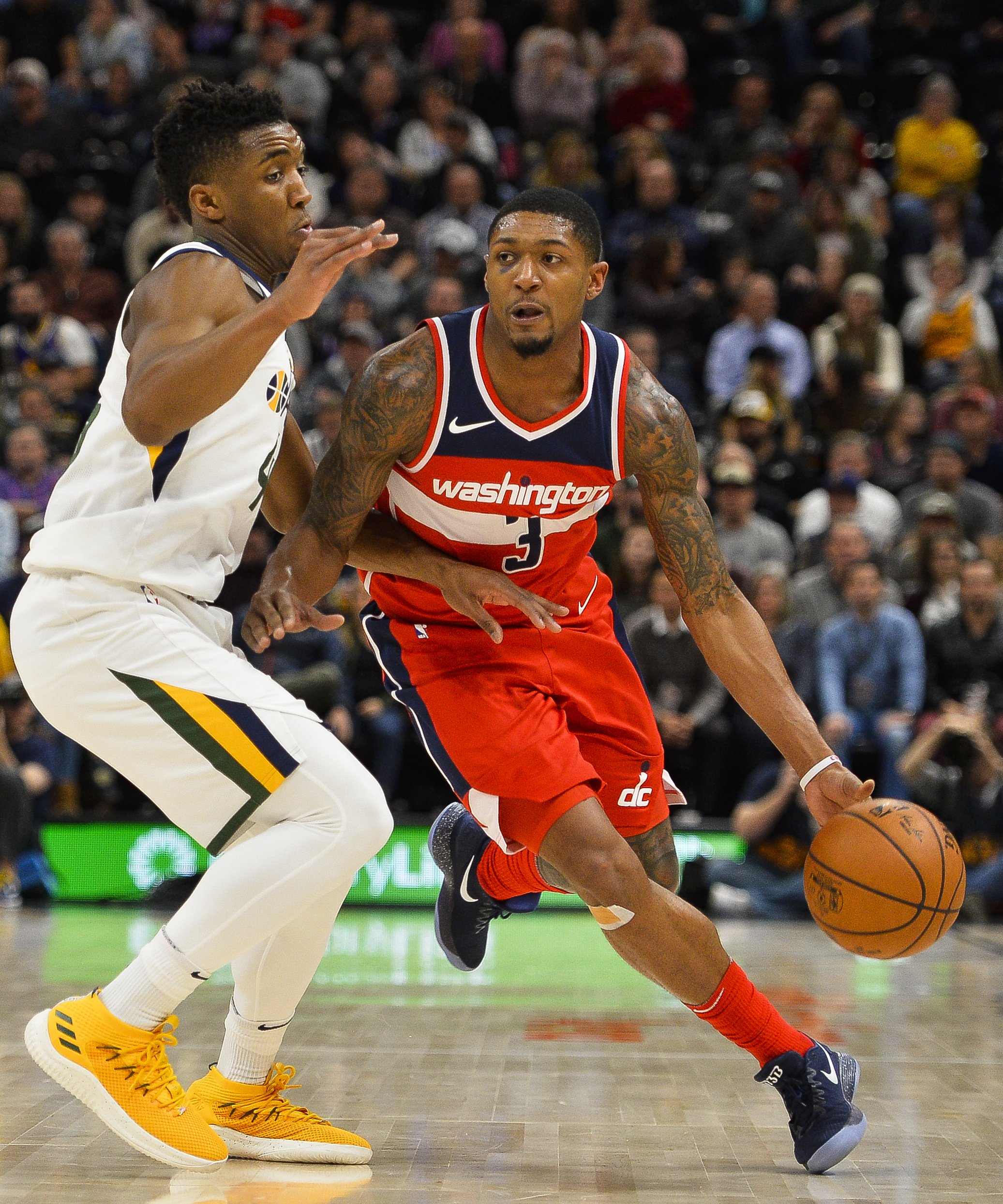 Utah Jazz guard Donovan Mitchell, left, attempts to guard Washington Wizards guard Bradley Beal, right, in the first half of an NBA basketball game Monday, Dec. 4, 2017, in Salt Lake City. (AP Photo/Alex Goodlett)