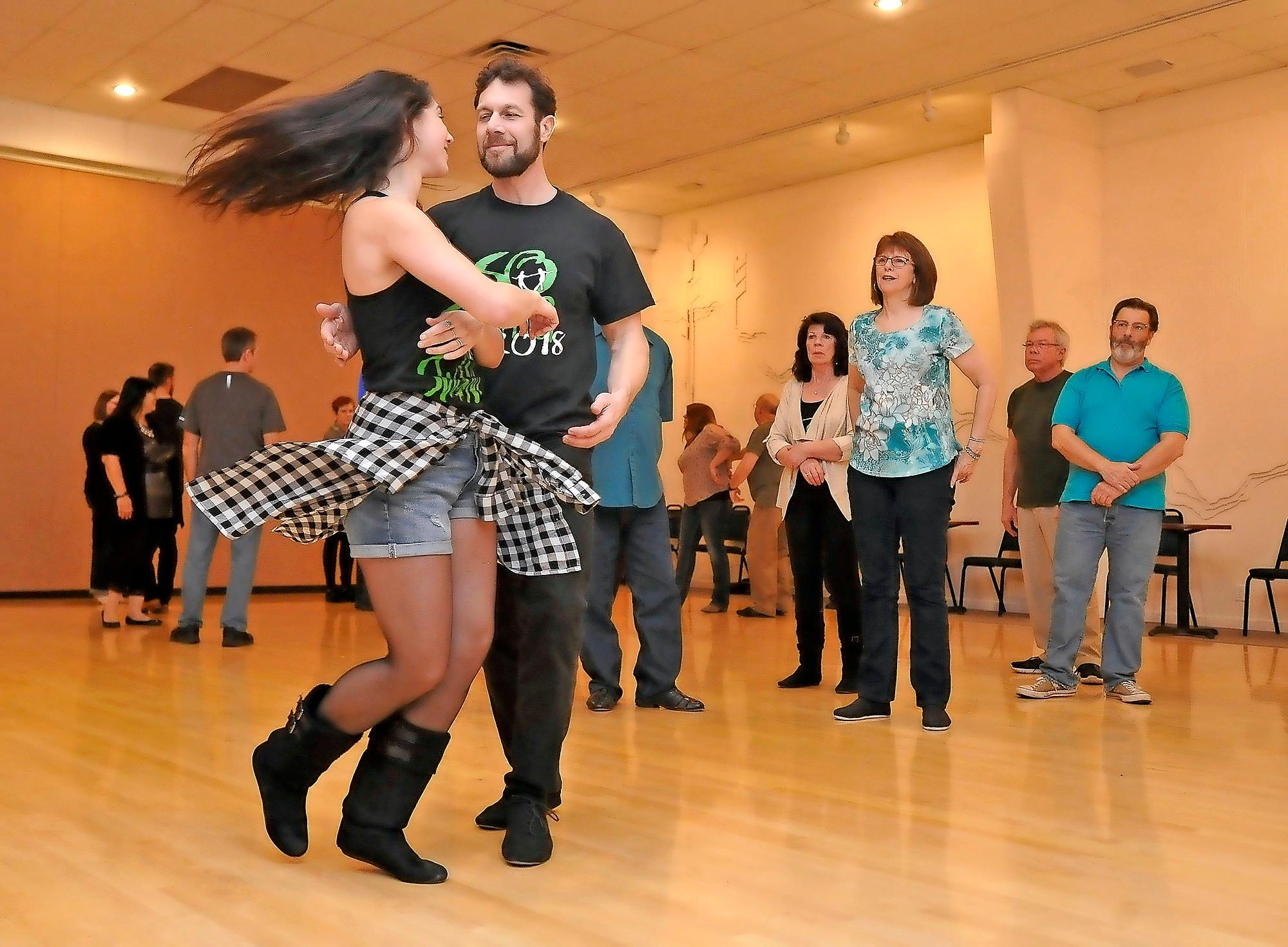 Dave Kahn and Tess Minnick give a swing dance class at the Evergreen Ballroom. - PHOTO BY DENISE BARATTA