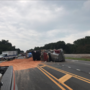 Overturned tractor trailer carrying dirt shuts down Highway 90