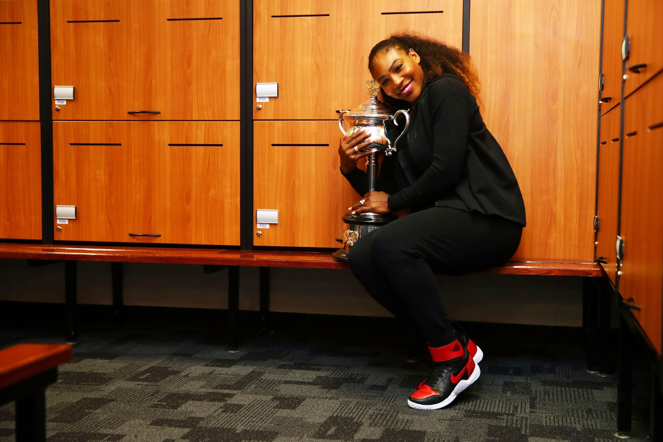 MELBOURNE, AUSTRALIA - JANUARY 28:  Serena Williams of the United States poses with the Daphne Akhurst Trophy in the changerooms after winning the Women's Singles Final against Venus Williams of the United States on day 13 of the 2017 Australian Open at Melbourne Park on January 28, 2017 in Melbourne, Australia.  (Photo by Clive Brunskill/Getty Images)