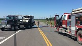 Major crash leads to mail truck fire, road closed