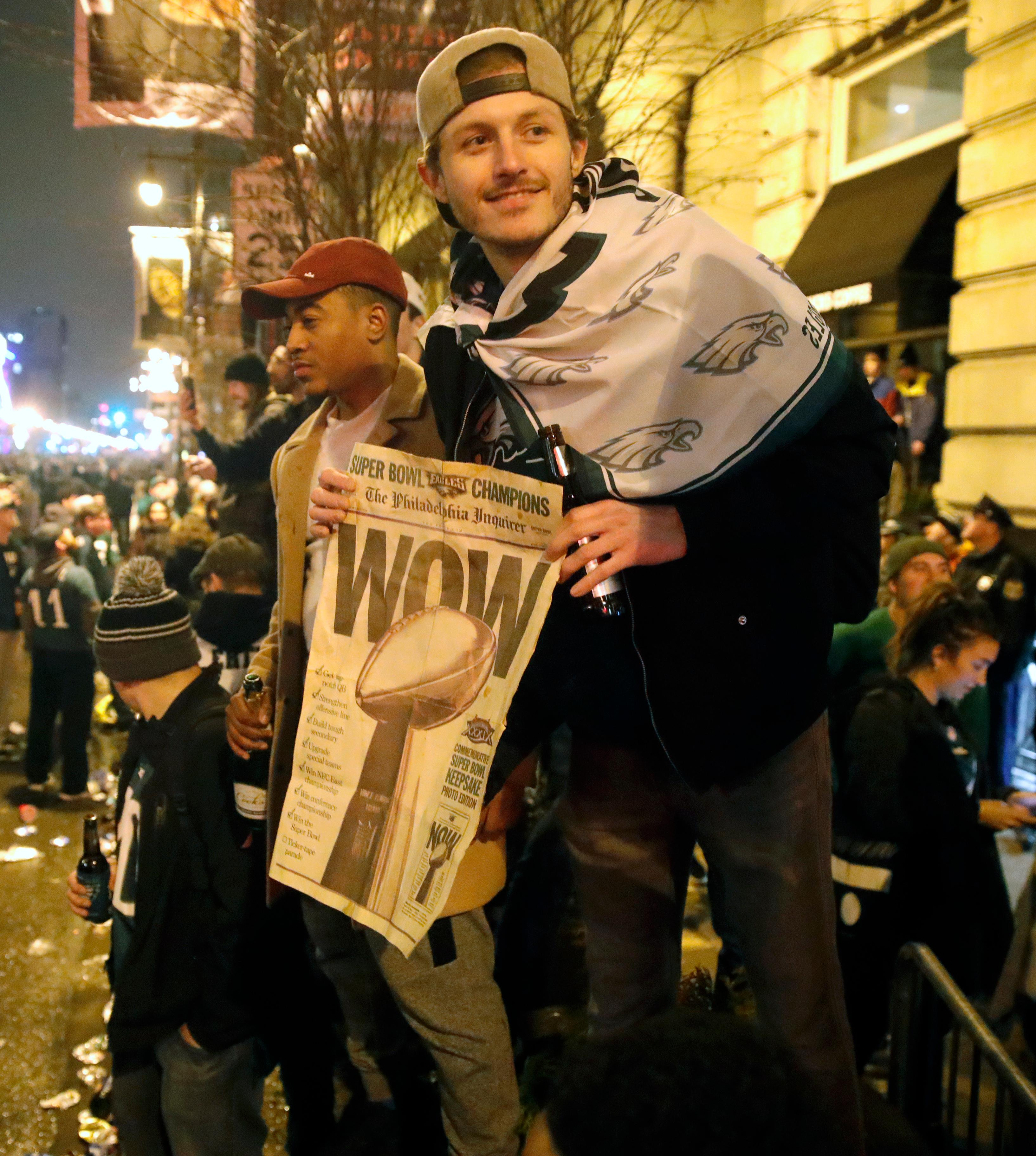 Philadelphia Eagles fans celebrate the team's victory in NFL Super Bowl 52 between the Philadelphia Eagles and the New England Patriots, Monday, Feb. 5, 2018, in downtown Philadelphia. (AP Photo/Matt Rourke)