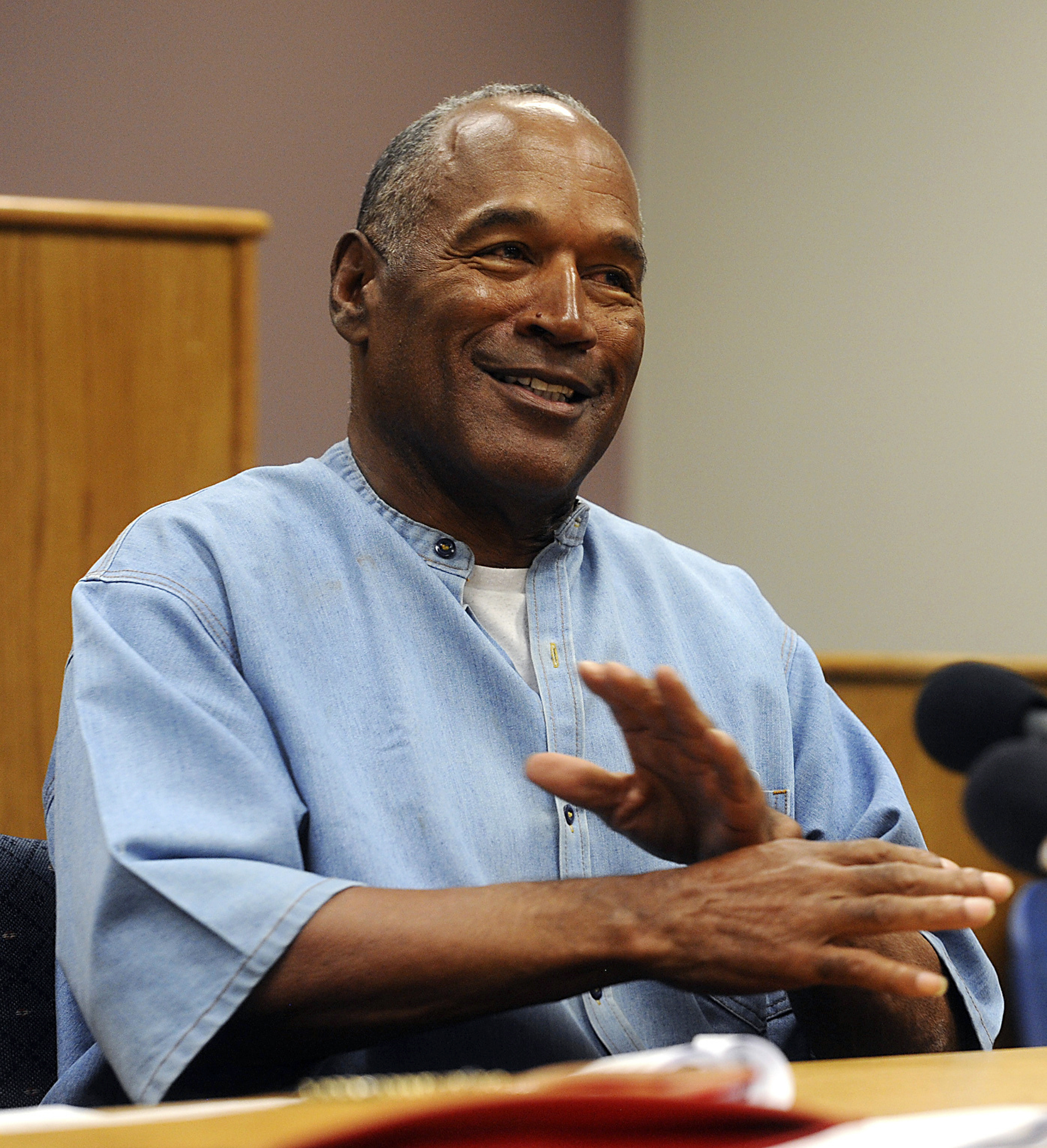 FILE - This July 20, 2017 file photo shows former NFL football star O.J. Simpson at his parole hearing at the Lovelock Correctional Center in Lovelock, Nev. Simpson was granted parole after more than eight years in prison for a Las Vegas hotel heist. A Nevada prison official said early Sunday, Oct. 1, 2017, O.J. Simpson, the former football legend and Hollywood star, has been released from a Nevada prison in Lovelock after serving nine years for armed robbery.  (Jason Bean/The Reno Gazette-Journal via AP, Pool, File)