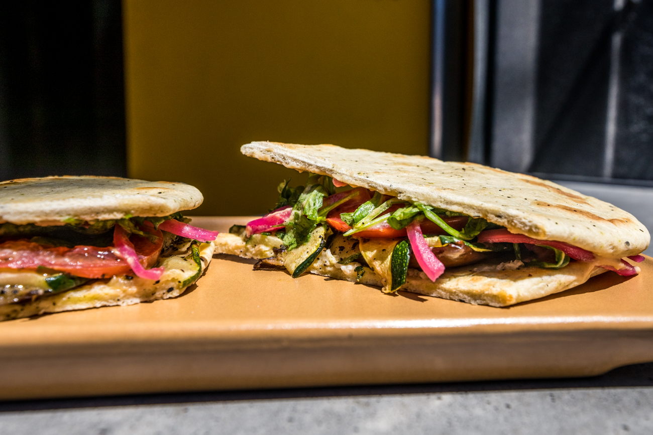 Veggie Sandwich: roasted eggplant and zucchini, Lost & Found hummus, pickled red onion, tomato, arugula, and Manchego cheese served on house-made pita bread / Image: Catherine Viox // Published: 5.16.20