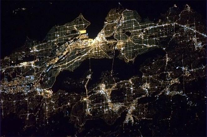 Seattle Washington, glowing brightly on early Easter Sunday morning.  (Photo & Caption: Chris Hadfield/NASA)