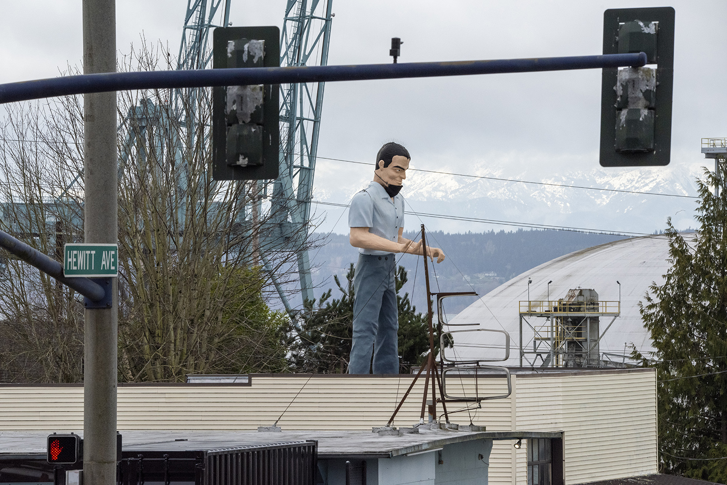 Take a drive along Hewitt Avenue in Everett and you'll soon notice one of the tallest men in the city: The Stevedore Muffler Man. And he's even sporting a face mask. (Rachael Jones / Seattle Refined)