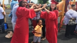 Preschool students celebrate graduation with high school seniors
