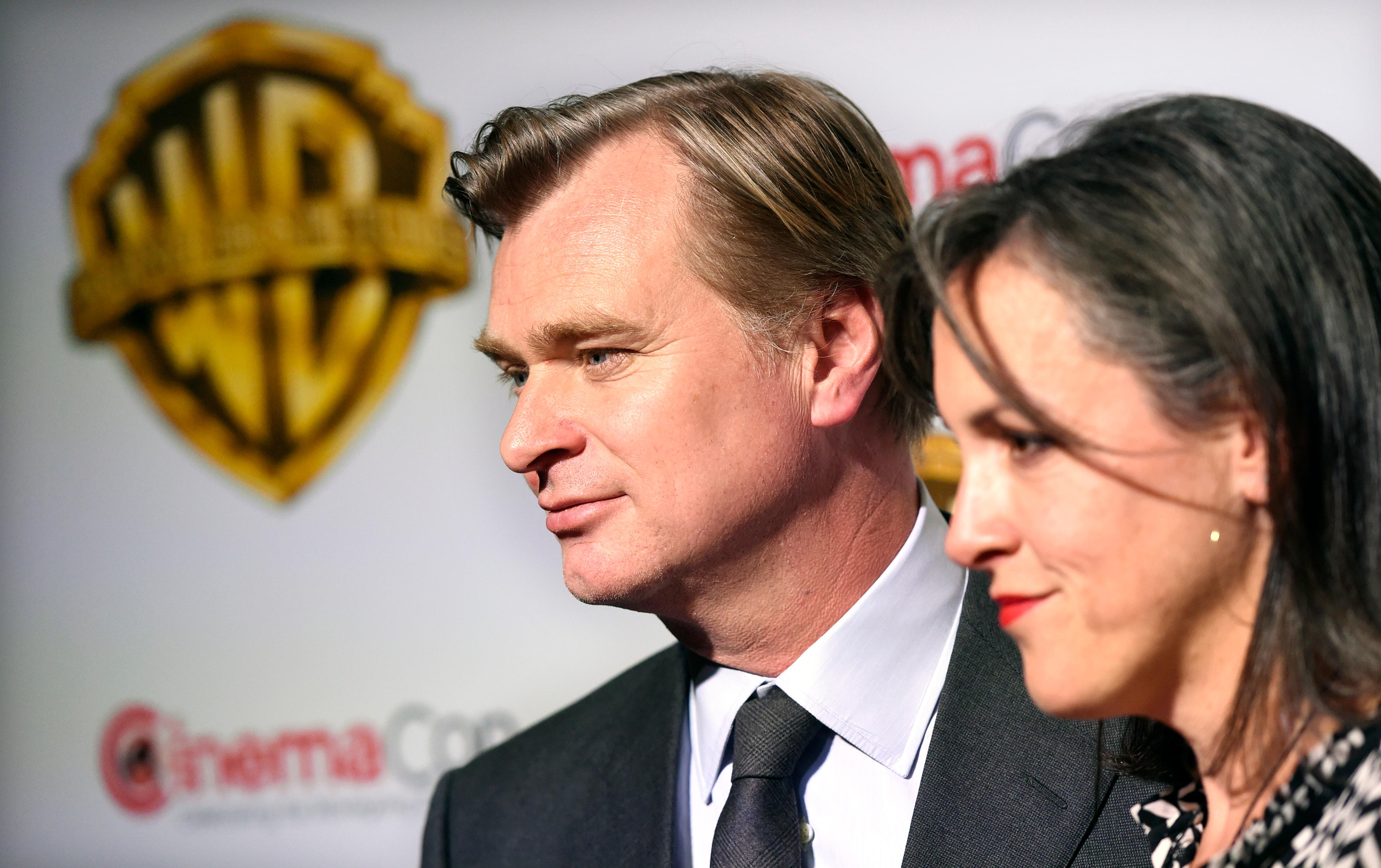 "Christopher Nolan, director of the upcoming film ""Dunkirk,"" and his wife, the film's producer Emma Thomas, pose together before the Warner Bros. Pictures presentation at CinemaCon 2017 at Caesars Palace on Wednesday, March 29, 2017, in Las Vegas. (Photo by Chris Pizzello/Invision/AP)"