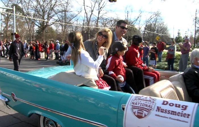Alabama offensive coordinator Doug Nussmeier and his family ride in a vintage car during the BCS National Championship parade on Saturday, January 19, 2013.