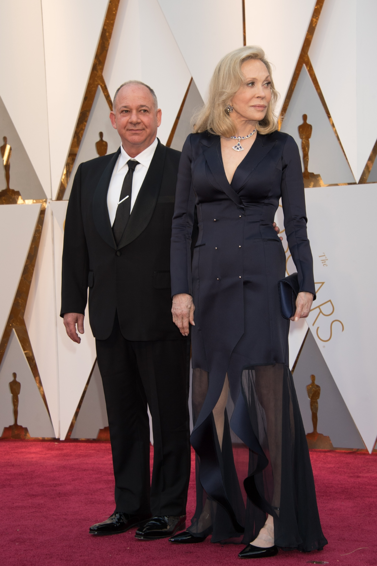 Guest and Faye Dunaway, presenter, arrive on the red carpet of The 89th Oscars® at the Dolby® Theatre in Hollywood, CA on Sunday, February 26, 2017. (A.M.P.A.S.)