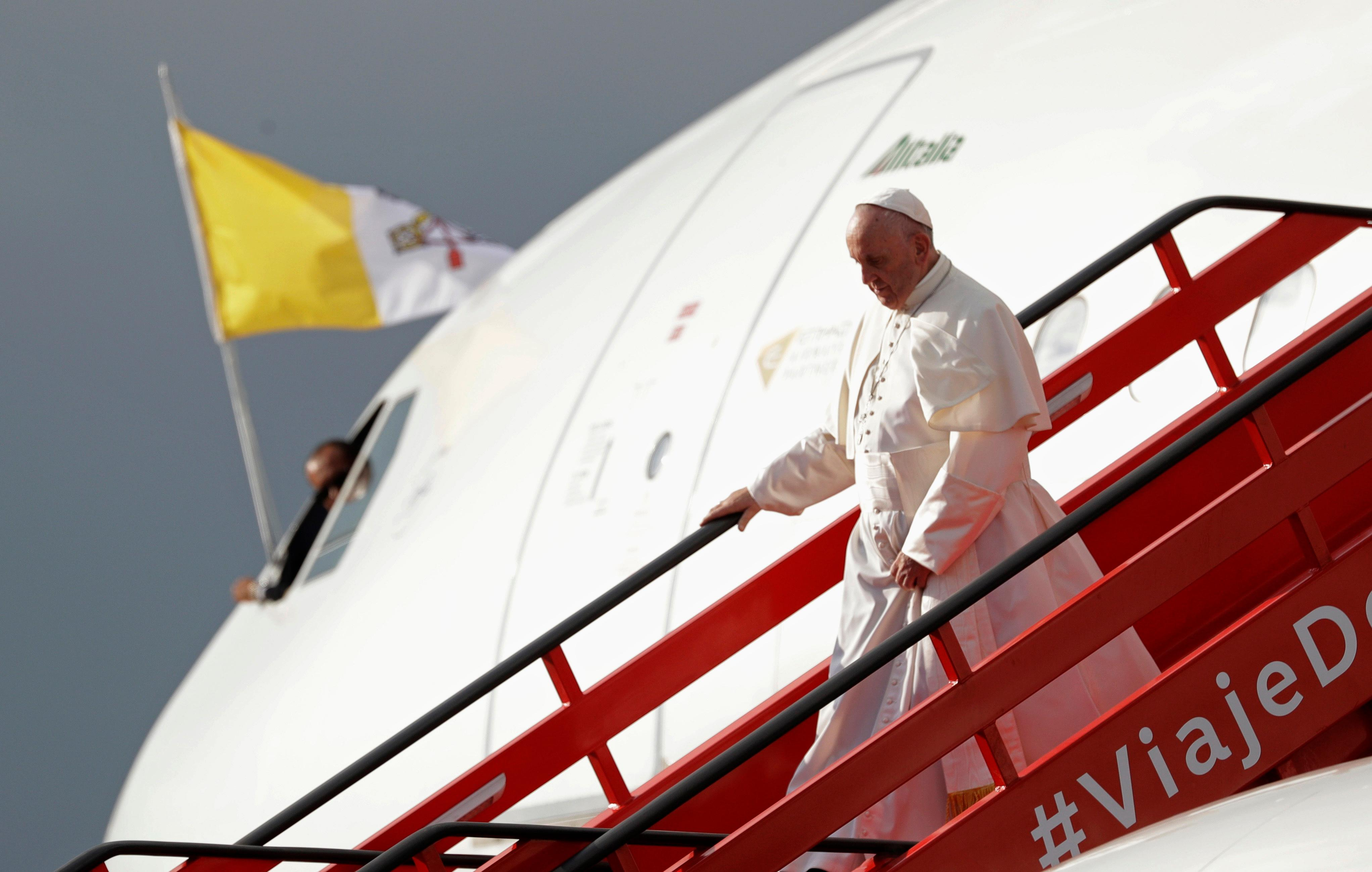 Pope Francis deplanes at El Dorado airport in Bogota, Colombia, Wednesday, Sept. 6, 2017. Pope Francis has arrived in Colombia for a five-day visit. (AP Photo/Andrew Medichini)