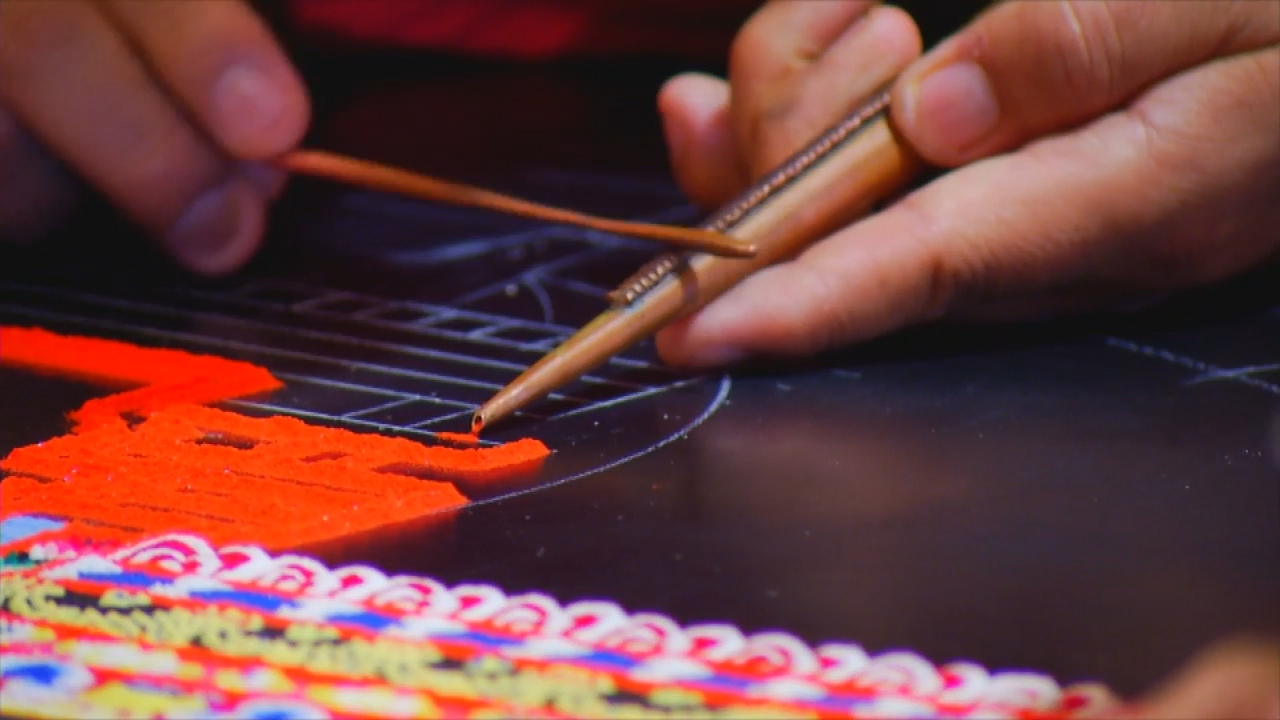 Tibetan monks from the Drepung Loseling Monastery area are visiting Western Carolina University through Thursday, Nov. 9, to construct a mandala sand painting and deliver a series of four lectures. (Photo credit: WLOS staff)