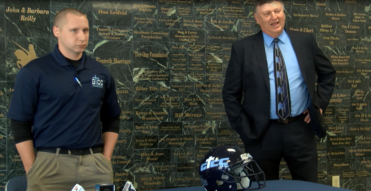 Tim Dvorak (left) in introduced by Howard Schumann as the next GICC football head coach, April 12, 2017 (NTV News)