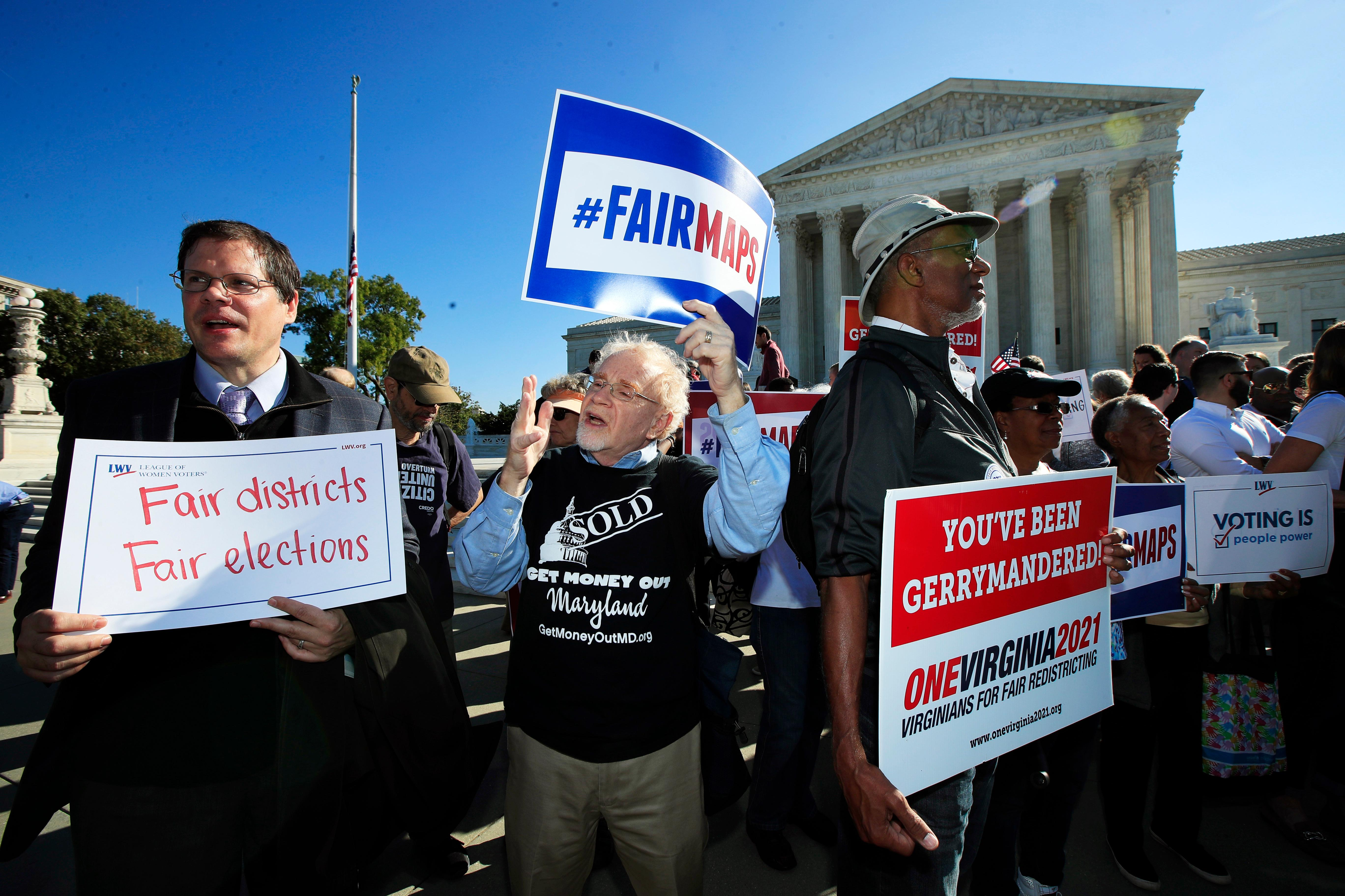 Eric Silberman from Silver Spring, Md., from left, Charlie Cooper from Baltimore, Md., and Clay Wilson from Alexandria, Va., join others in a rally for a fair election outside the U.S. Supreme Court in Washington, Tuesday, Oct. 3, 2017. The Supreme Court hears arguments in a case about political maps in Wisconsin that could affect elections across the country. (AP Photo/Manuel Balce Ceneta)