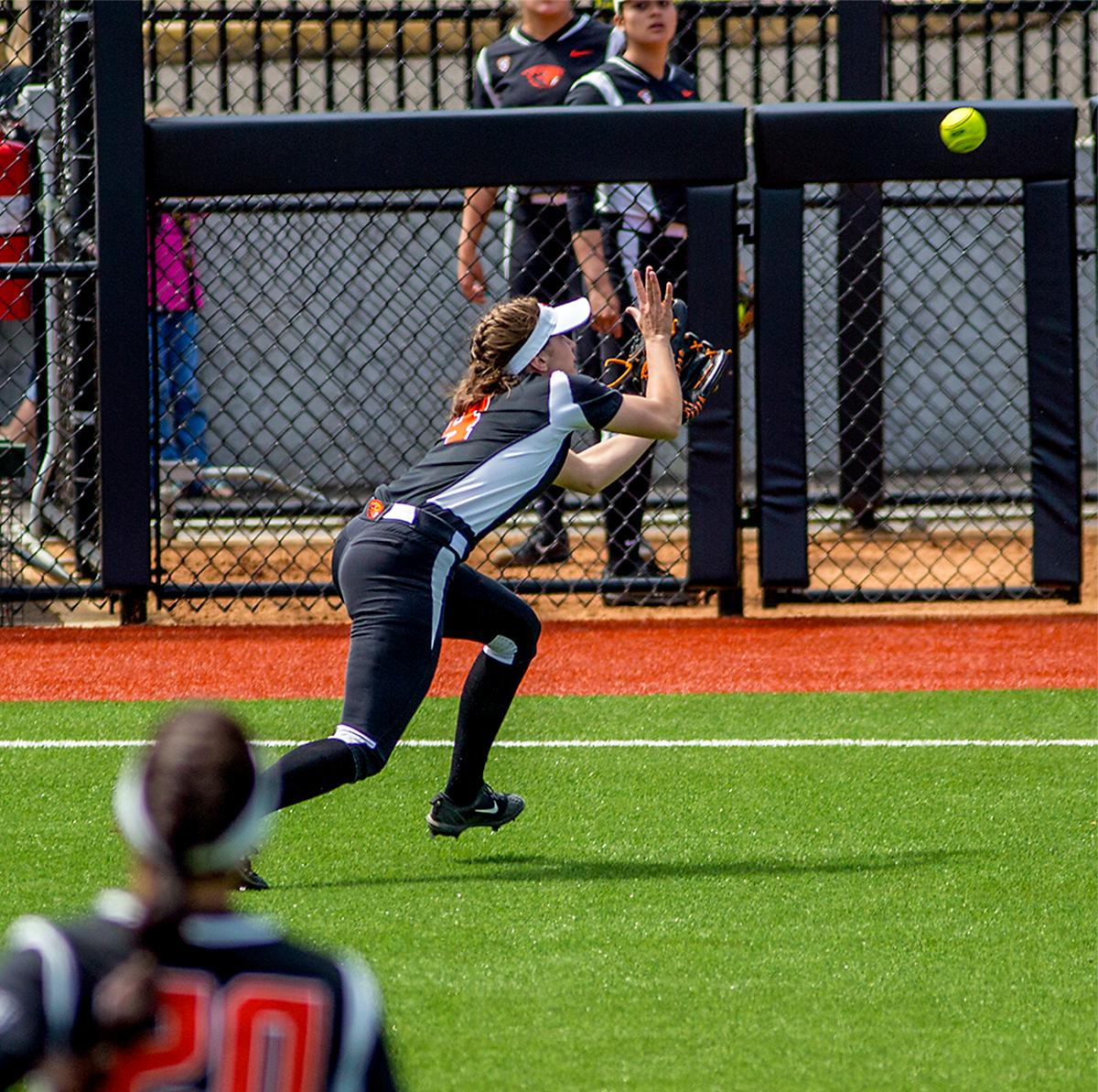 The Beavers Michelle Sass (#4) makes the catch in the outfield. The Oregon Ducks defeated the Oregon State Beavers 7-2 in game two of the three-game Civil War series at Jane Sanders Stadium on Saturday. The final game of the series will be on Sunday at 3:00 p.m. at Jane Sanders Stadium. Photo by August Frank, Oregon News Lab