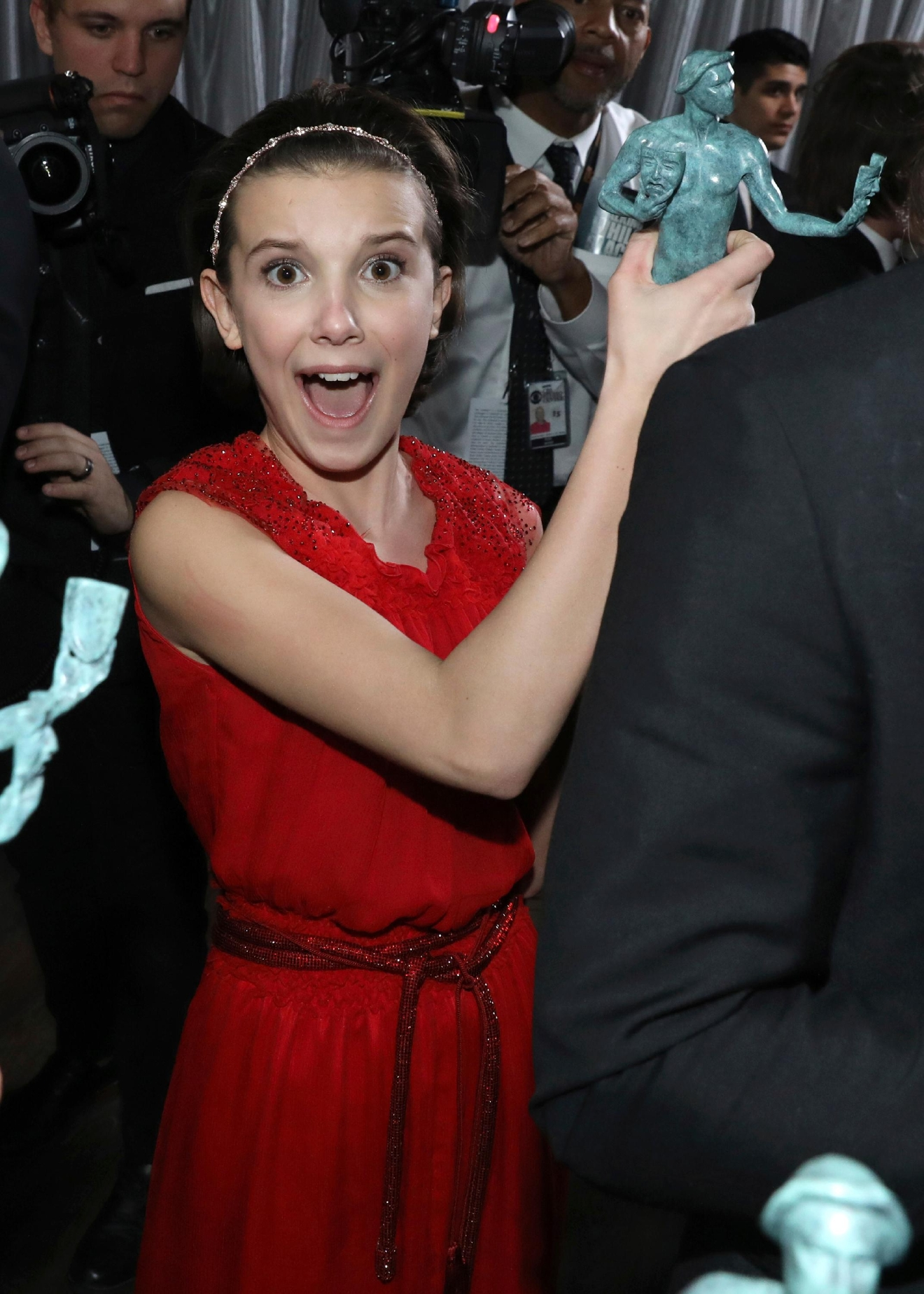 "Millie Bobby Brown appears backstage with the award for outstanding performance by an ensemble in a drama series for ""Stranger Things"" at the 23rd annual Screen Actors Guild Awards at the Shrine Auditorium & Expo Hall on Sunday, Jan. 29, 2017, in Los Angeles. (Photo by Matt Sayles/Invision/AP)"