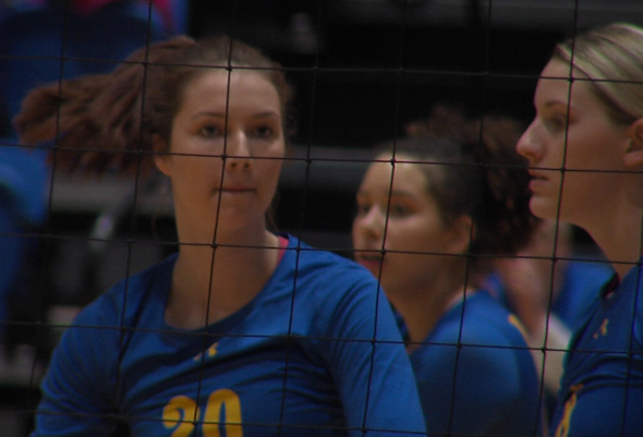UNK outside hitter Kendall Schroer (left) reacts after a kill in a match with PIttsburg State as Josie Cox (far right) looks on, Nov. 3, 2017 (KHGI)<p></p>