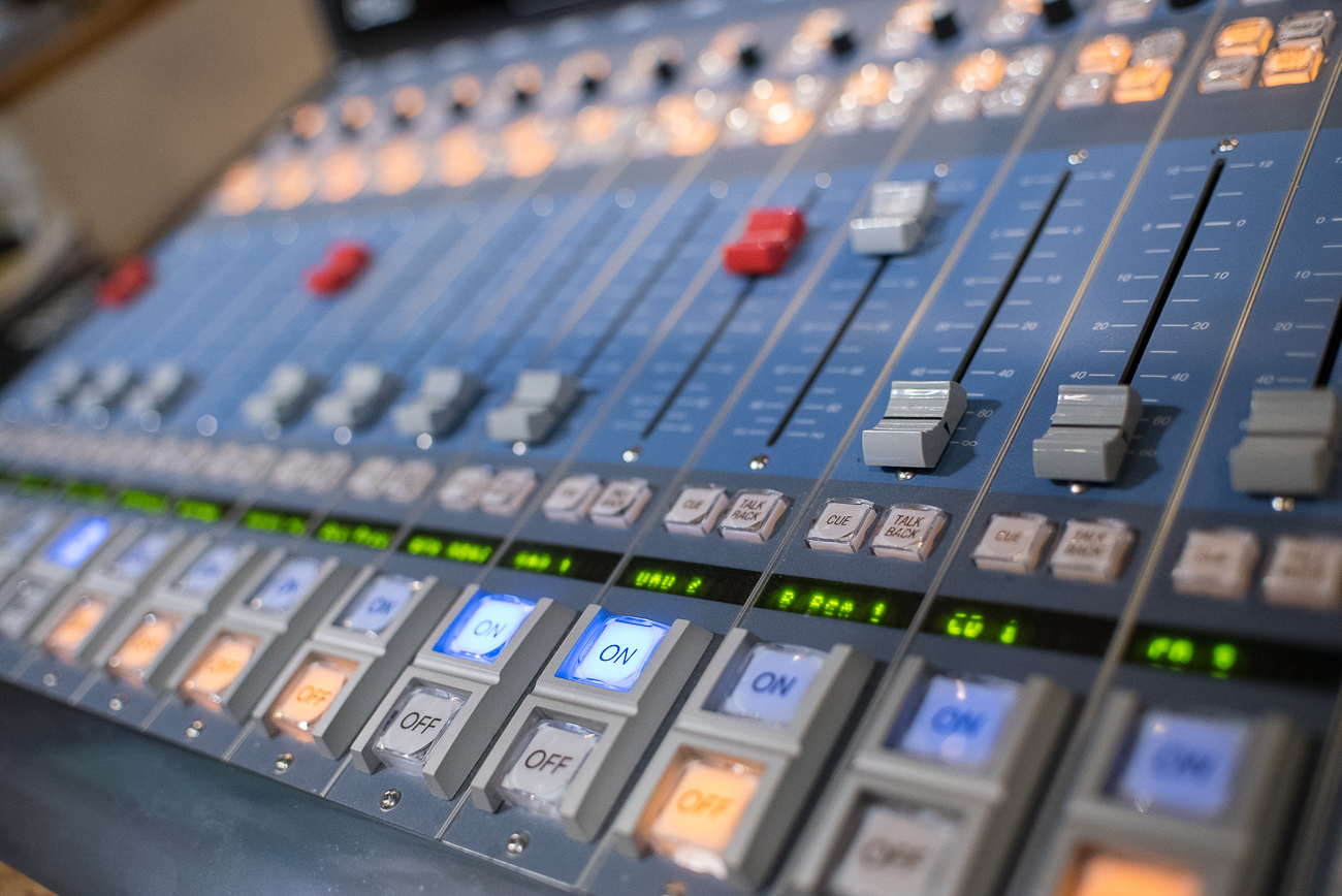 The control board is how the broadcaster switches between the national NPR feed and their own live readings. It is located on the desk directly below the microphone. / Image: Phil Armstrong, Cincinnati Refined // Published: 12.12.17<p></p>