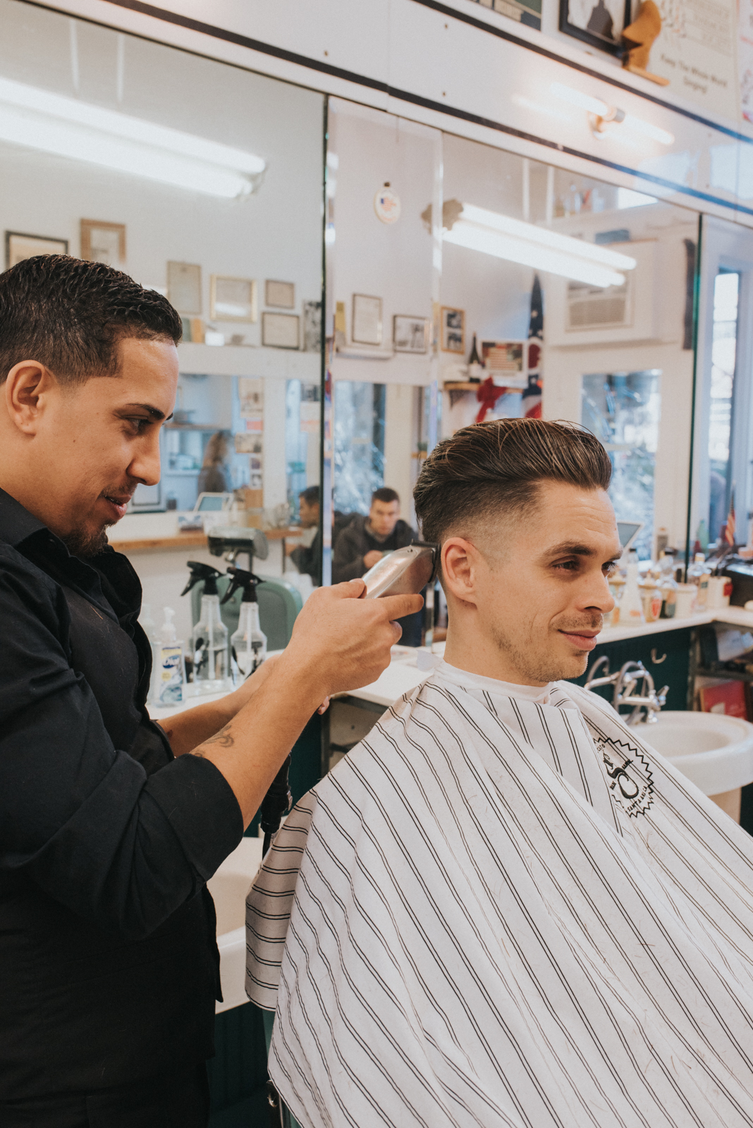 Barber Felix cutting Levi's hair / Image: Brianna Long // Published: 12.29.17<p></p>