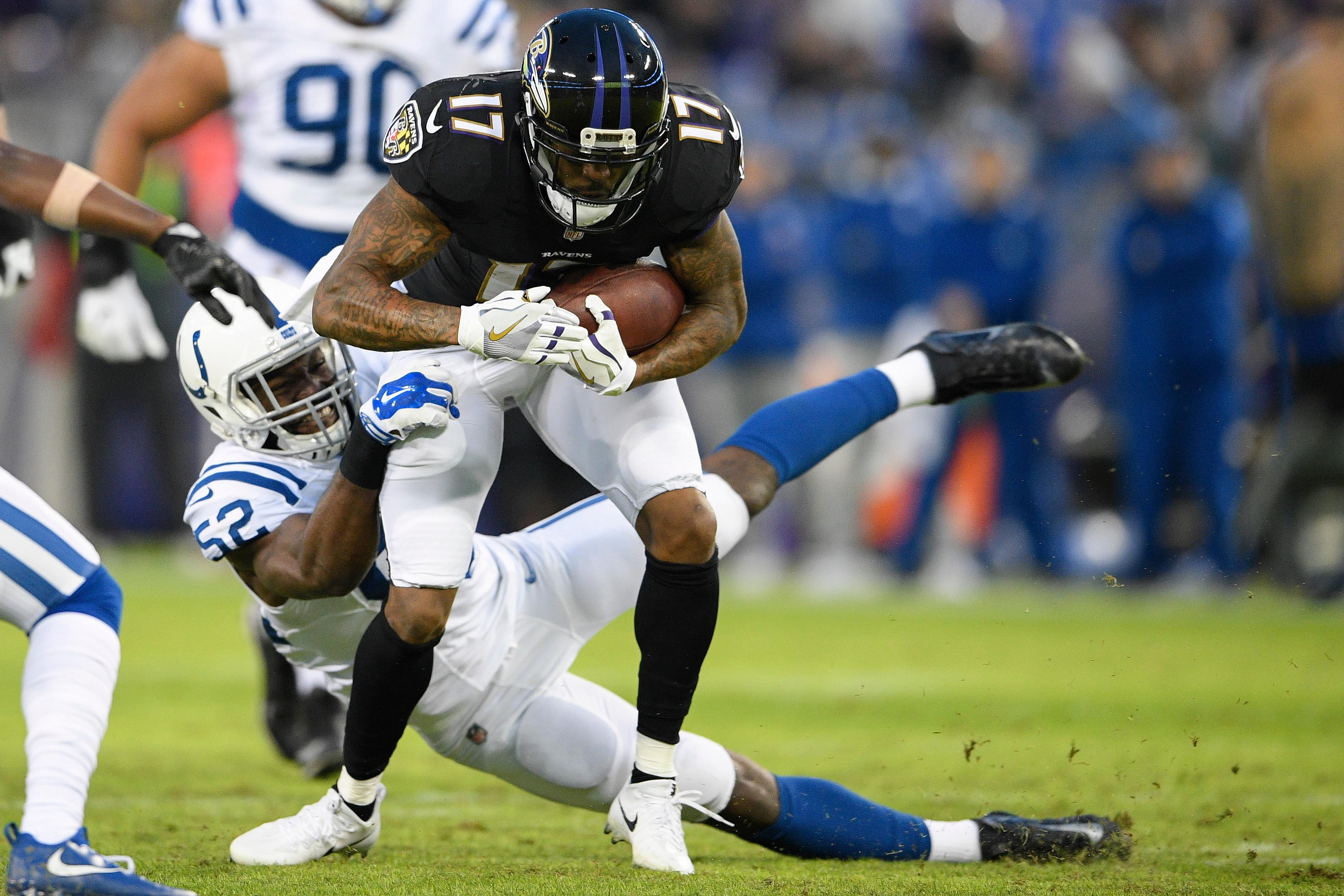 Baltimore Ravens wide receiver Mike Wallace (17) is stopped by Indianapolis Colts outside linebacker Barkevious Mingo (52) during the first half of an NFL football game in Baltimore, Saturday, Dec 23, 2017. (AP Photo/Nick Wass)