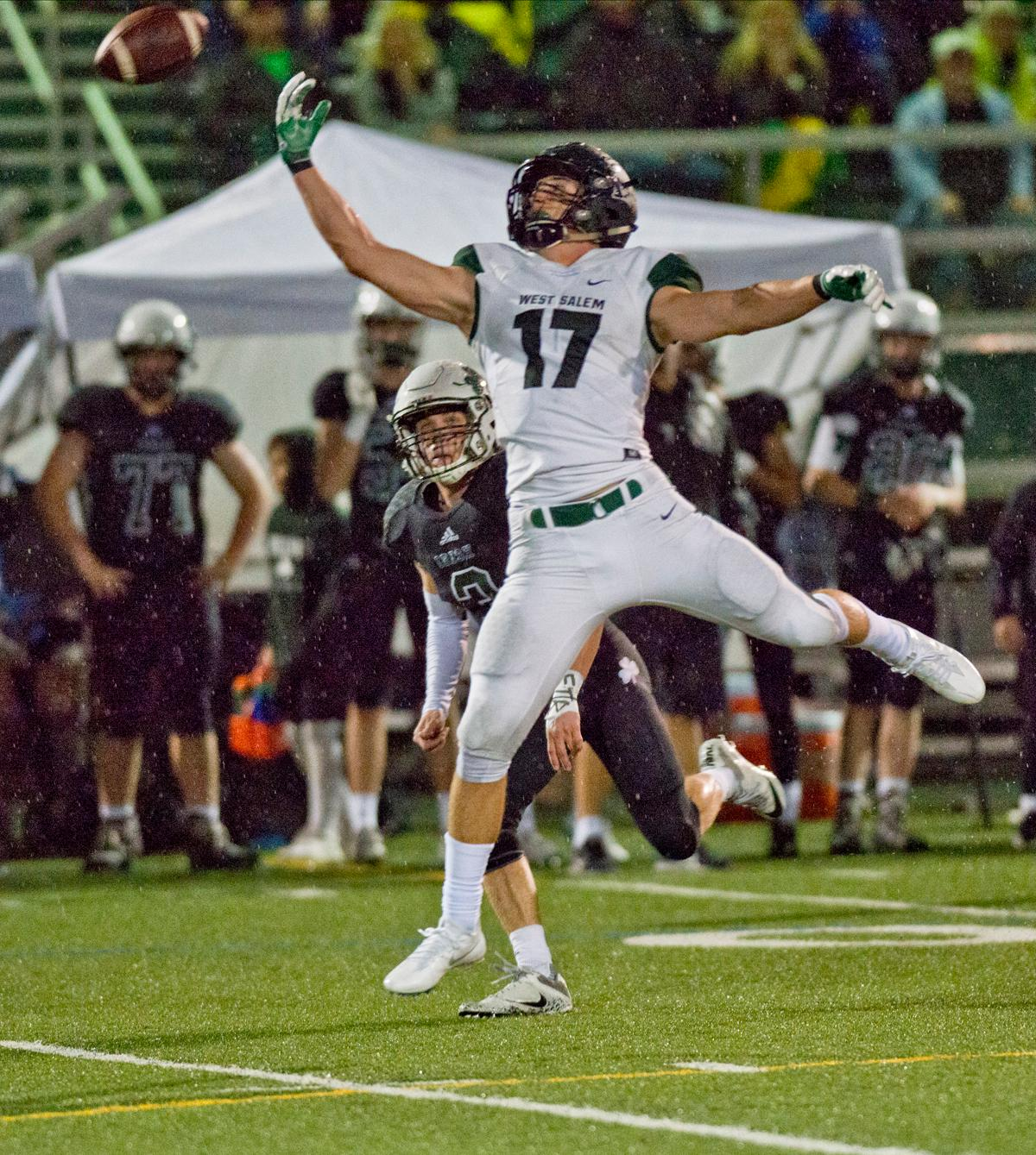 West Salem Titans wide receiver Micah Pugh (#17) can't bring in a long pass. On a rainy Monday evening Sheldon defeated West Salem 41-7. The game had been postponed from Friday due to unhealthy levels of smoke in the atmosphere due to nearby forest fires. Photo by Dan Morrison, Oregon News Lab