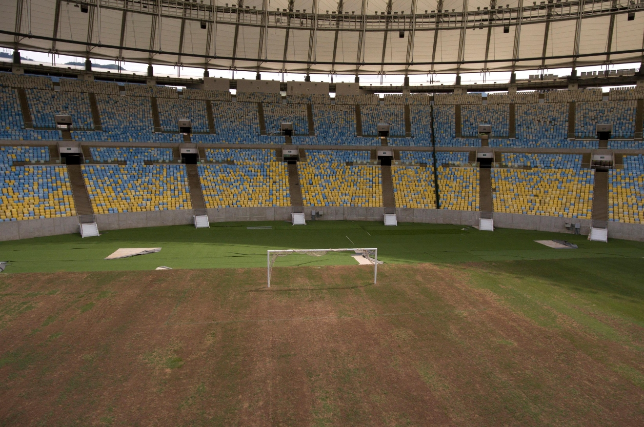 This Feb. 2, 2017 shows the dry soccer field inside Maracana stadium in Rio de Janeiro, Brazil. The stadium was renovated for the 2014 World Cup at a cost of about $500 million, and largely abandoned after the Olympics and Paralympics, then hit by vandals who ripped out thousands of seats and stole televisions. (AP Photo/Mario Lobao)