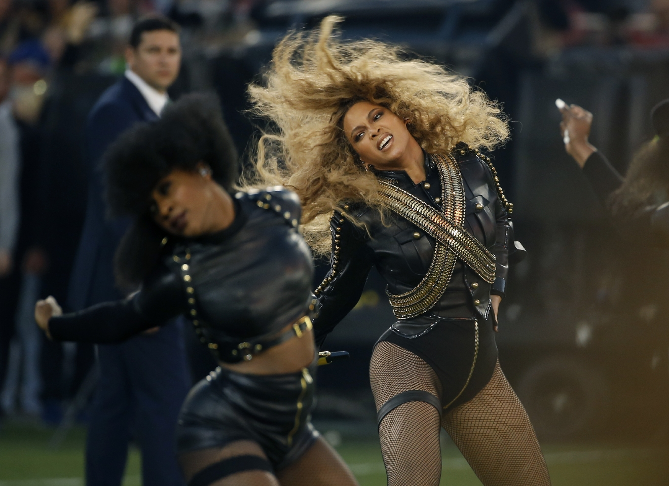 FILE - In this Feb. 7, 2016, file photo, Beyonce performs during halftime of the NFL Super Bowl 50 football game in Santa Clara, Calif. In a surprise appearance, Beyonce strode onstage in sparkling pinstripes Monday, June 6, 2016, to speak emotionally about both family and fashion at the annual Council of Fashion Designers of America awards ceremony. (AP Photo/Matt Slocum, File)