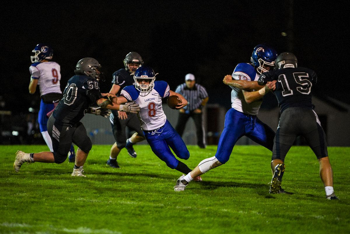 Churchill running back Dalton McDaniel (#8) breaks multiple tackles to score a long touchdown in the Lancer's 56-7 victory over Springfield remaining 7-0 on the season. Photo by Jeff Dean, Oregon News Lab