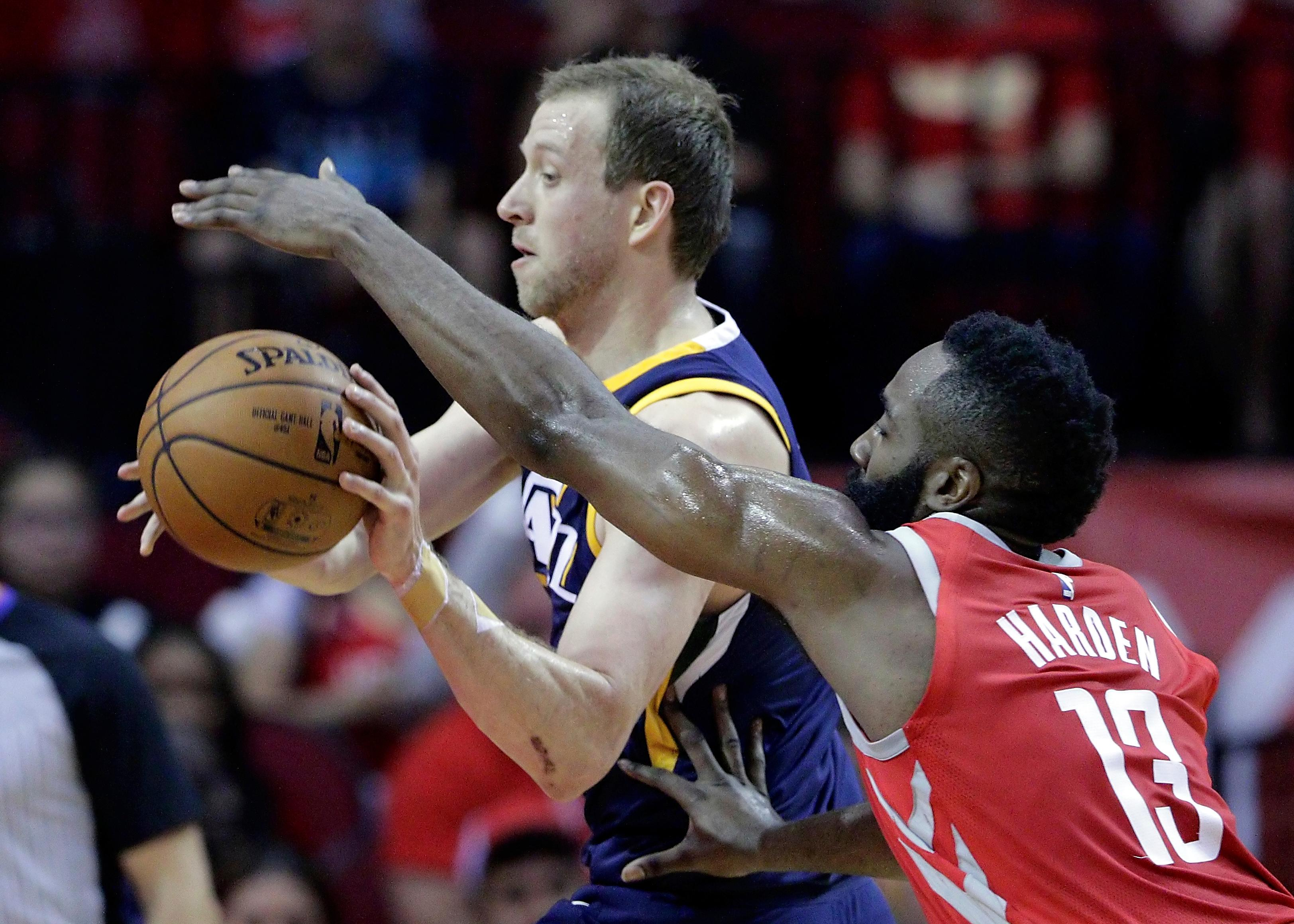 Utah Jazz forward Joe Ingles (2) looks to pass as Houston Rockets guard James Harden (13) reaches for the ball in the first half of an NBA basketball game Sunday, Nov. 5, 2017, in Houston. (AP Photo/Michael Wyke)
