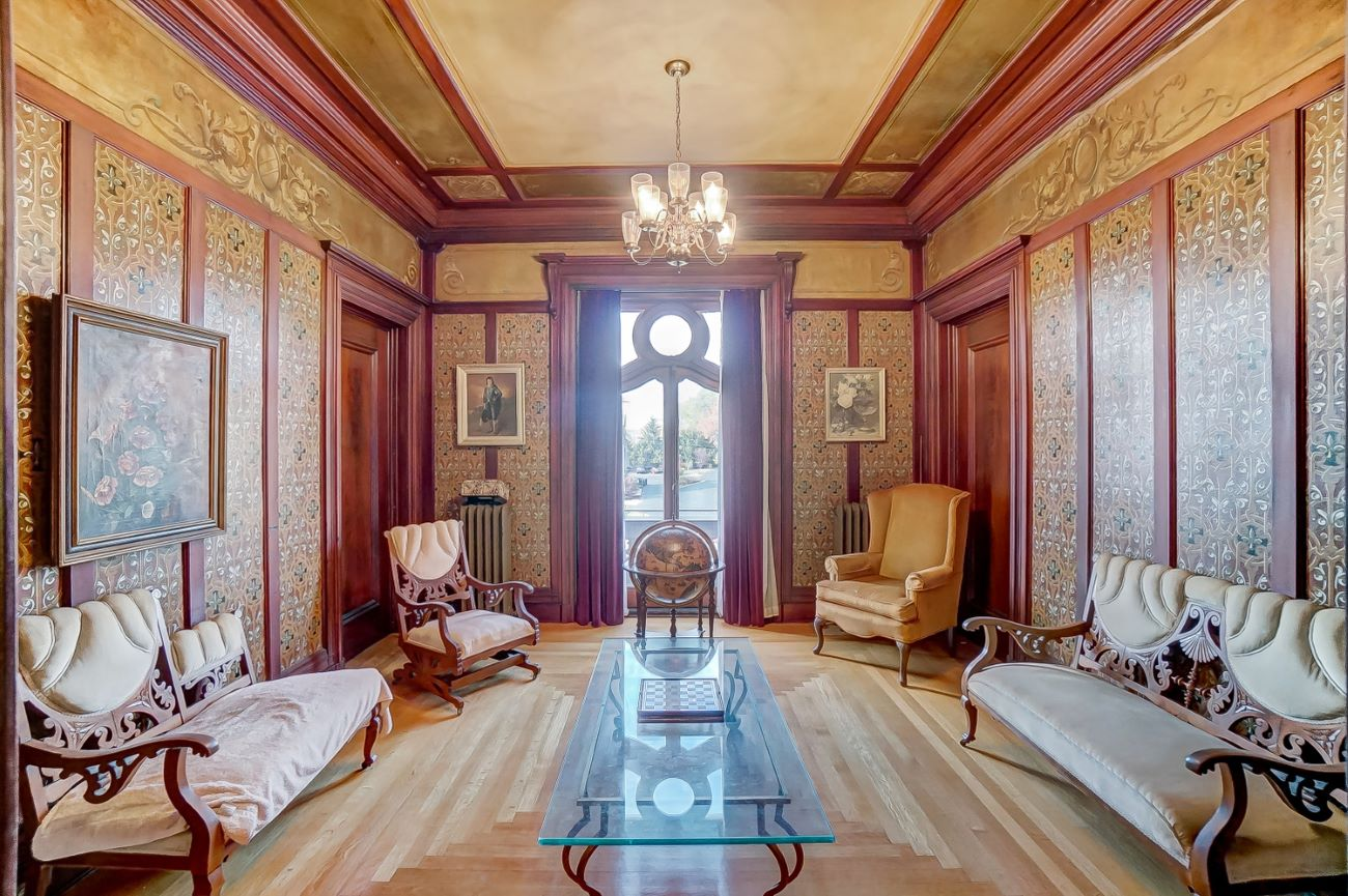 The walls in the sitting room are carved and painted as a beautiful example of Beaux Arts style. / Image: Adam Sanregret courtesy of Coldwell Banker West Shell // Published: 4.3.20