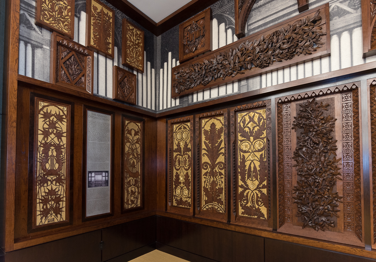 Decorative, wood-carved panels from Music Hall's original organ (1878) hang on three walls inside the Taft Suite. The organ lasted nearly 100 years before being dismantled in 1971 to make way for a new electronic organ. The panels were preserved, and the public took notice of them again in 2011 when the Society for the Preservation of Music Hall collected and restored them. / Image: Phil Armstrong, Cincinnati Refined // Published: 11.11.17