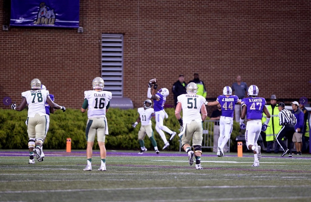 "JMU 31, WILLIAM & MARY 24: An interception in the end zone by CB Taylor Reynolds (below) with 1:22 remaining preserved JMU's 24-17 lead. Three plays later, Khalid Abdullah scored on a 74-yard run to clinch a thrilling win befitting the rivalry. ""I told the kids that today was the 39th meeting, and the total score differential was a 1-point lead for JMU,"" said Dukes head coach Mike Houston. JMU now leads the series 22-17 — and by 8 points. (Photo courtesy JMU Athletics)"