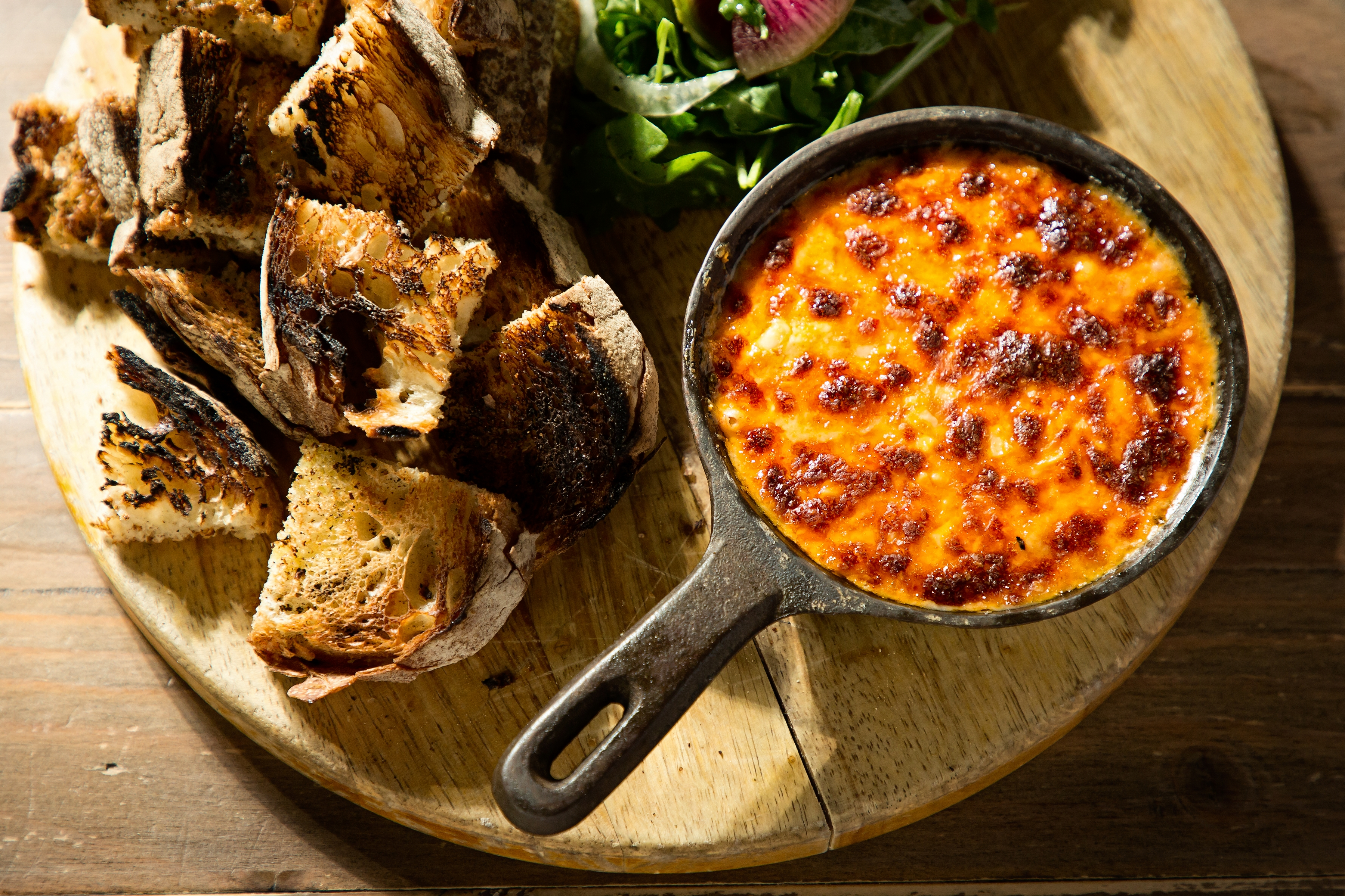 "<p>""The fondue at The Fainting Goat is by far the most popular dish on the menu,"" says executive chef and partner Nathan Beauchamp. It must be the melted goat cheese, Fresno peppers and herbs and accompanied by grilled bread for dipping that keeps diners coming back for more of this brunch fondue. On the dinner menu, it comes with grilled bread and shaved fennel. (Image: Scott Suchman){&nbsp;}</p>"