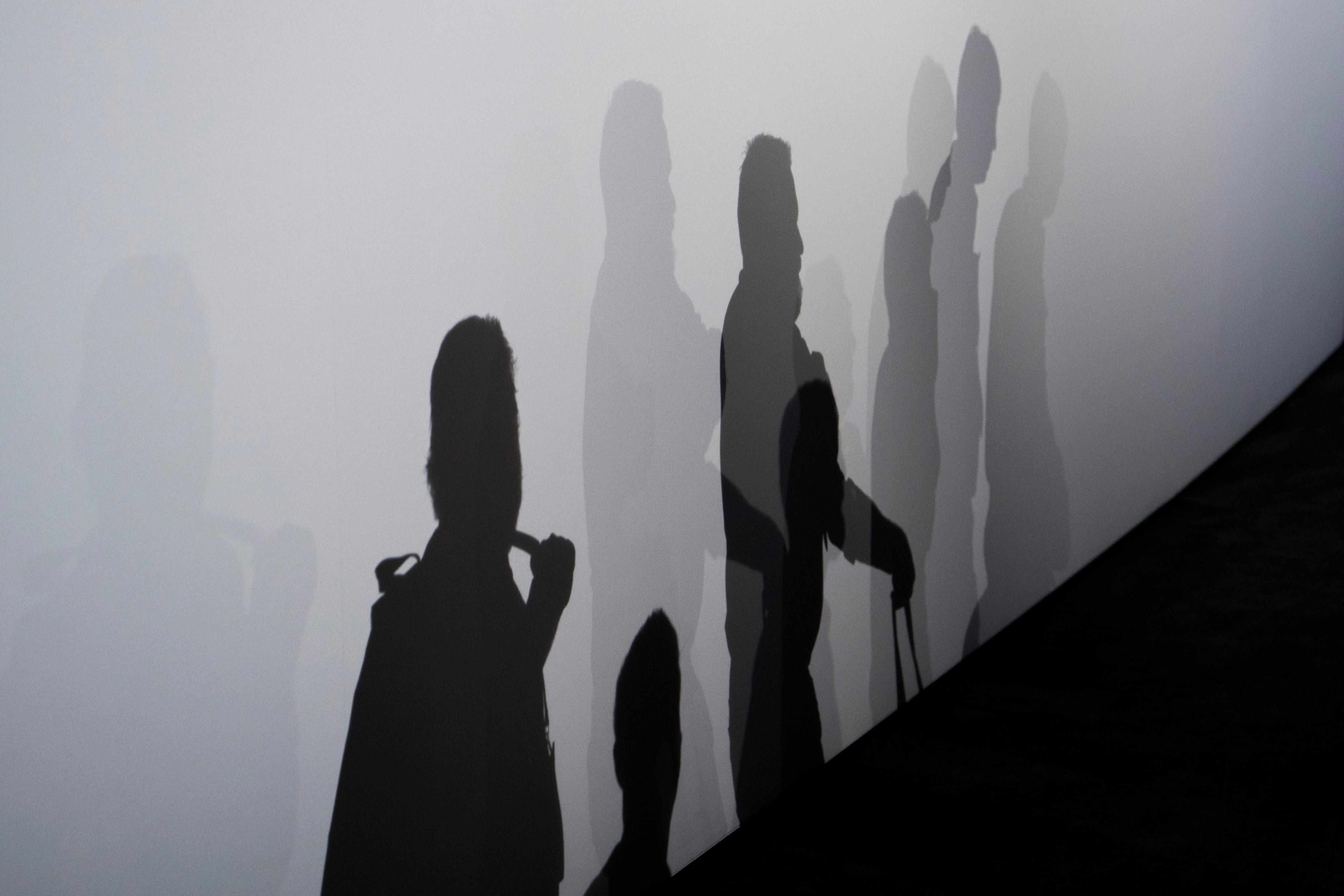 Attendees cast shadows on the wall during the second day of CES Wednesday, January 10, 2018, at the Las Vegas Convention Center. CREDIT: Sam Morris/Las Vegas News Bureau