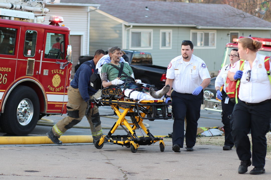 Man hospitalized after west Tulsa house fire (Courtesy of CJ Neal Photography)
