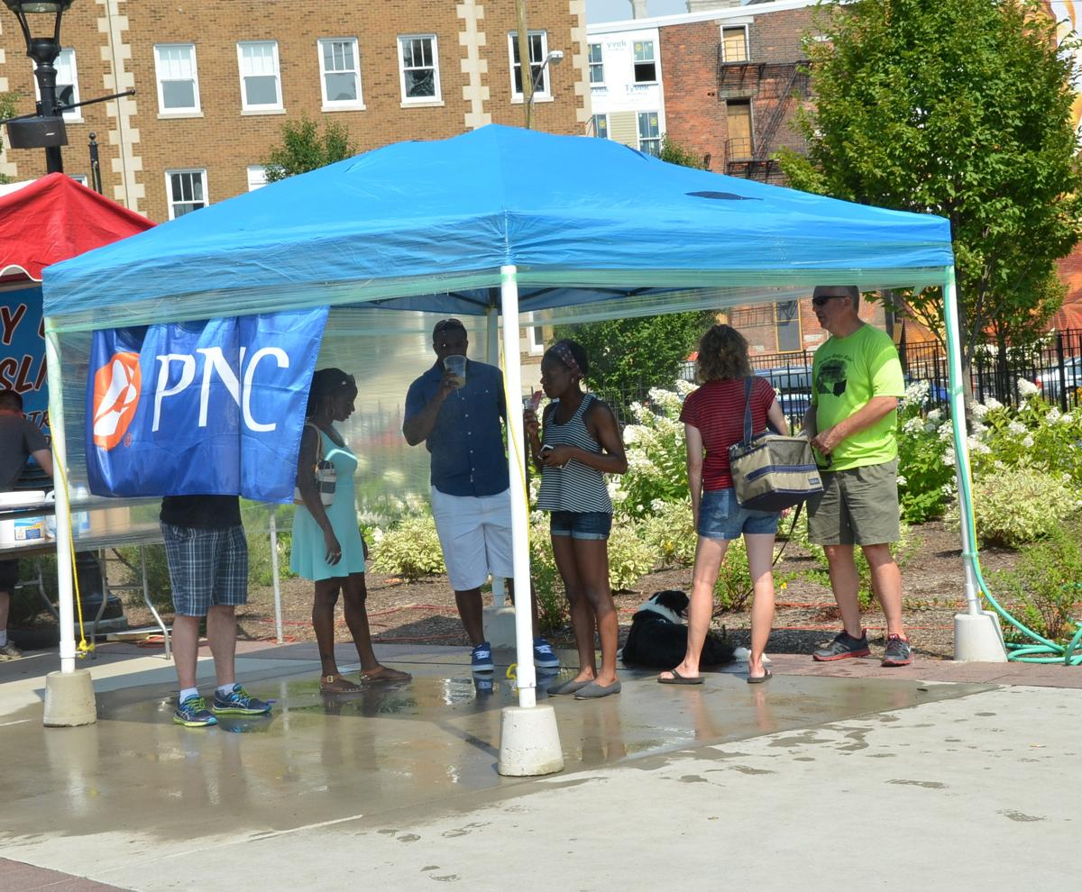 Enjoying a break from the heat at the PNC water tent (Image: Leah Zipperstein / Cincinnati Refined)