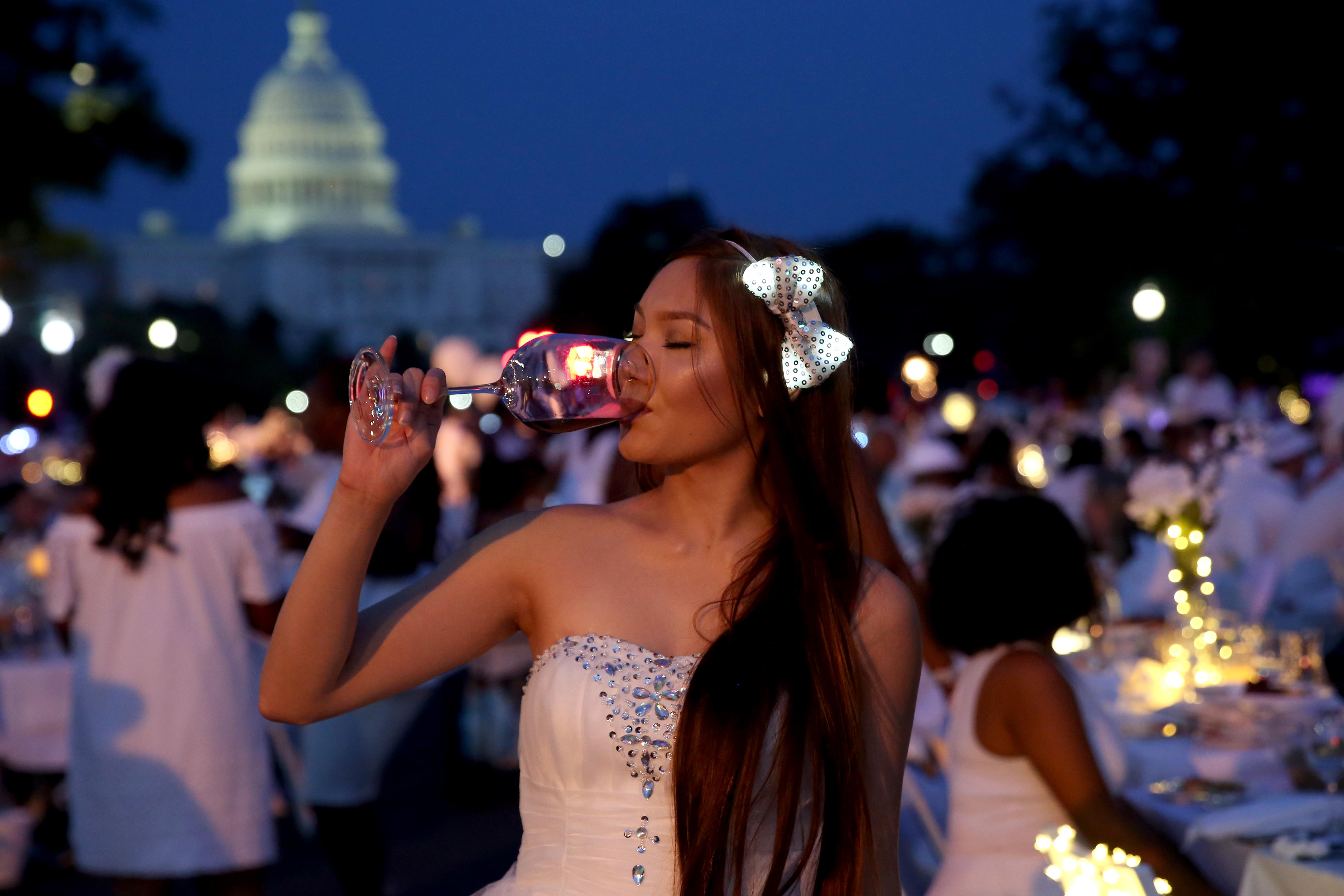 Maxine Duggan's hair bow was the perfect accessory after the sun set at Diner en Blanc.{ } (Amanda Andrade-Rhoades/DC Refined)