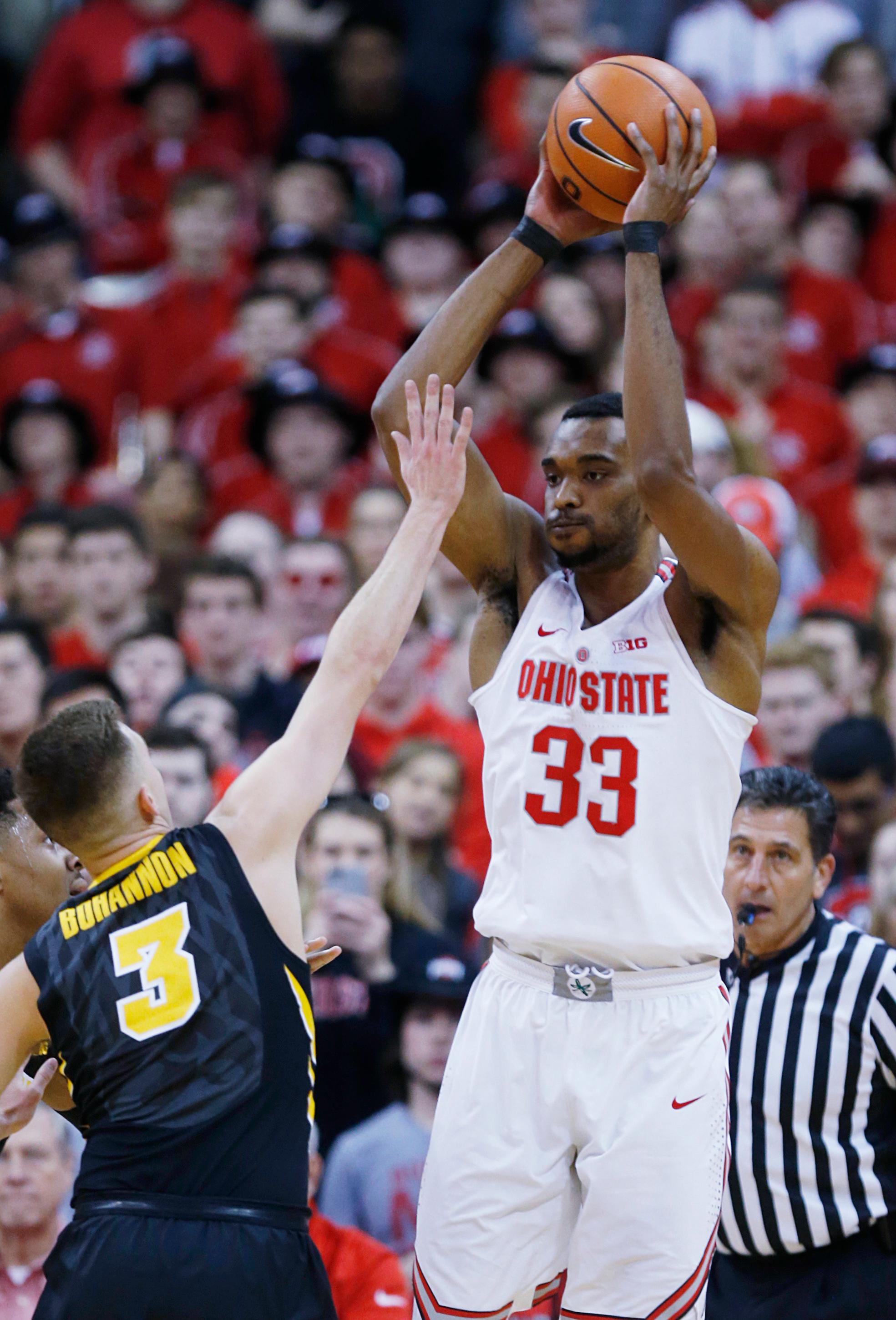 Ohio State forward Keita Bates-Diop, right, passes against Iowa guard Jordan Bohannon during the first half of an NCAA college basketball game in Columbus, Ohio, Saturday, Feb. 10, 2018. (AP Photo/Paul Vernon)
