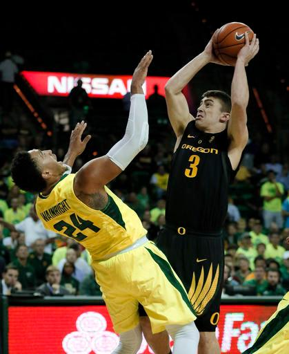Baylor guard Ishmail Wainright (24) is knocked backwards on a score by Oregon's Payton Pritchard (3) in the first half of an NCAA college basketball game, Tuesday Nov. 15, 2016, in Waco, Texas. (AP Photo/Tony Gutierrez)