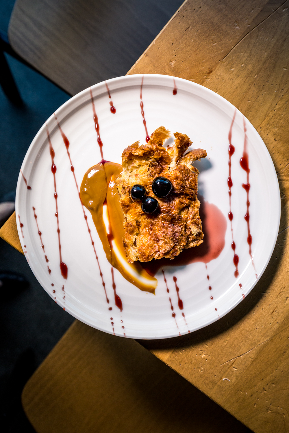 Parlor Bread Pudding: buttery and soft croissant bread pudding with homemade warm caramel sauce, Luxardo cherries, and cherry cordial drizzle / Image: Catherine Viox{ }// Published: 10.10.19