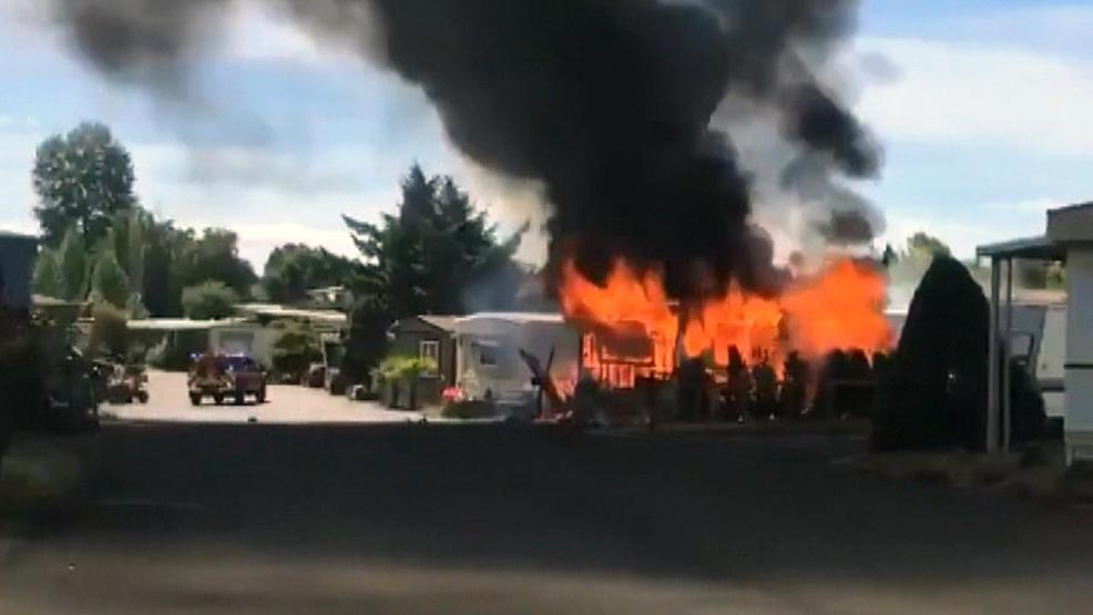 Two men save 95-year-old woman from burning Beaverton mobile home | Car Fire Near Mobile Home on church on fire, nursing home fire, grill fire, trailer fire, motor home fire, roseville home fire, forest fire, people on fire, dwelling fire, mobile fire rescue department, motorcycle fire, commercial fire, flat fire, recreational fire, mobile fire rescue training, tipi fire, apartment fire, maine home fire, restaurant fire,