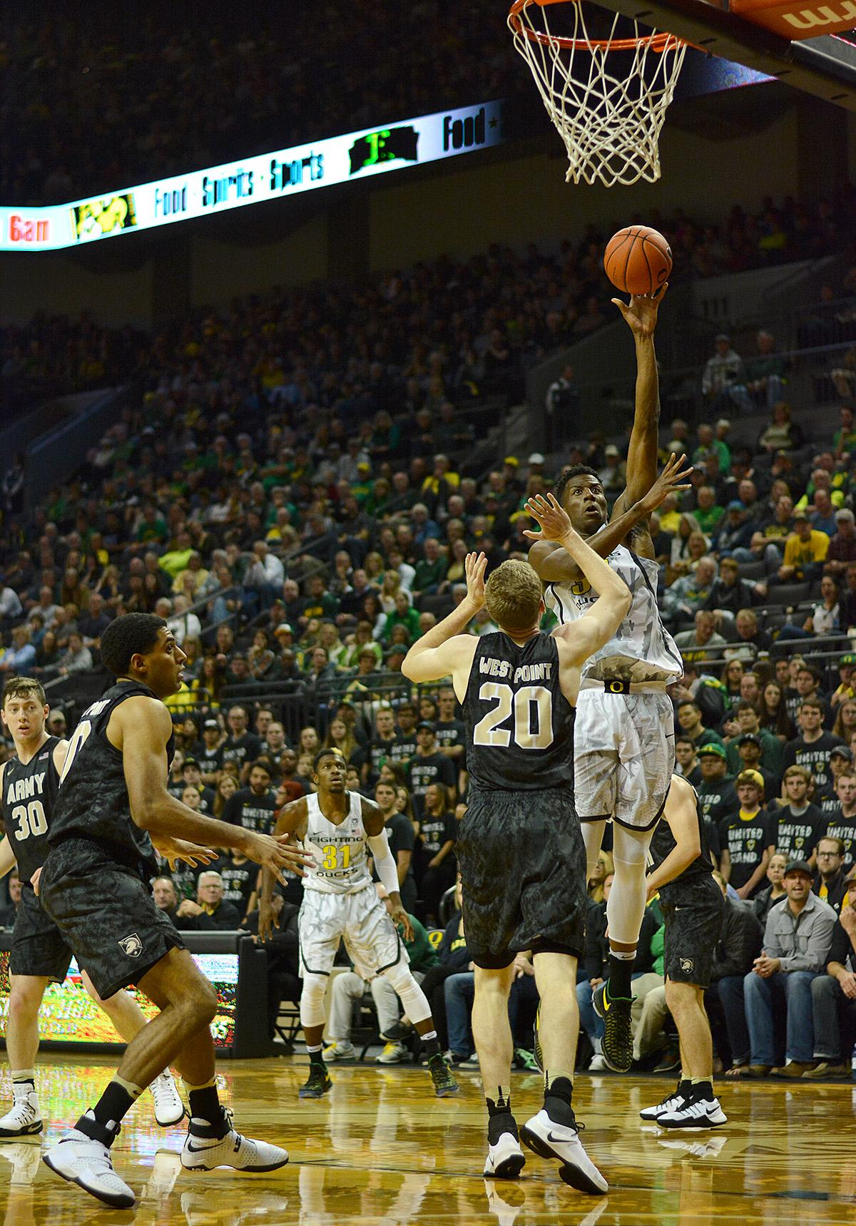 Ducks' Kavell Bigby-Williams (#35) rises above Army's Mac Hoffman (#20) to get the shot off for two points. In front of a sold out crowd, Oregon defeated Army 91-77 on opening night. Photo by Jacob Smith, Oregon News Lab